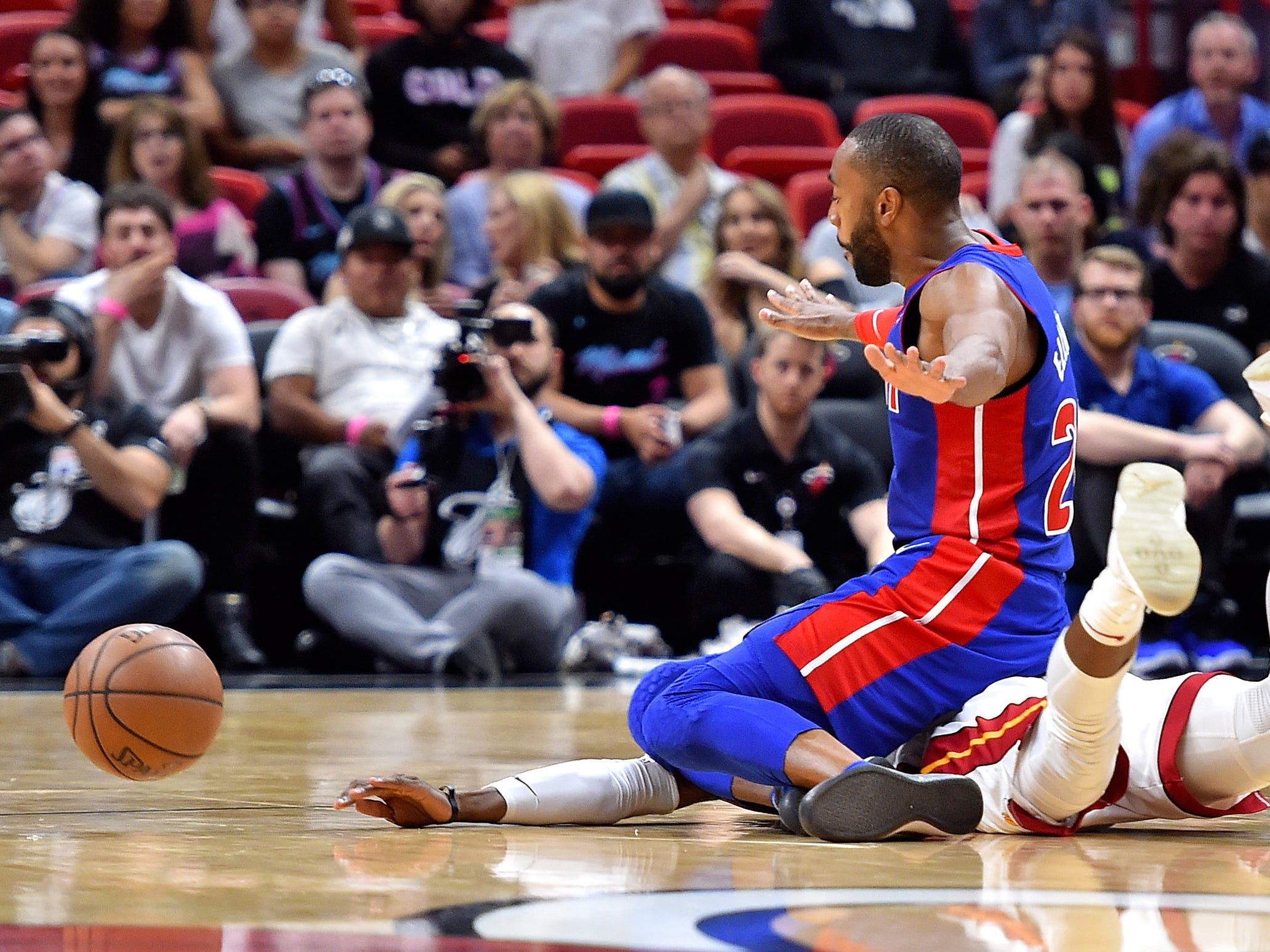 Detroit Pistons guard Wayne Ellington (20) collides with Miami Heat guard Josh Richardson (0) during the second half at American Airlines Arena on Wednesday, March 13, 2019.