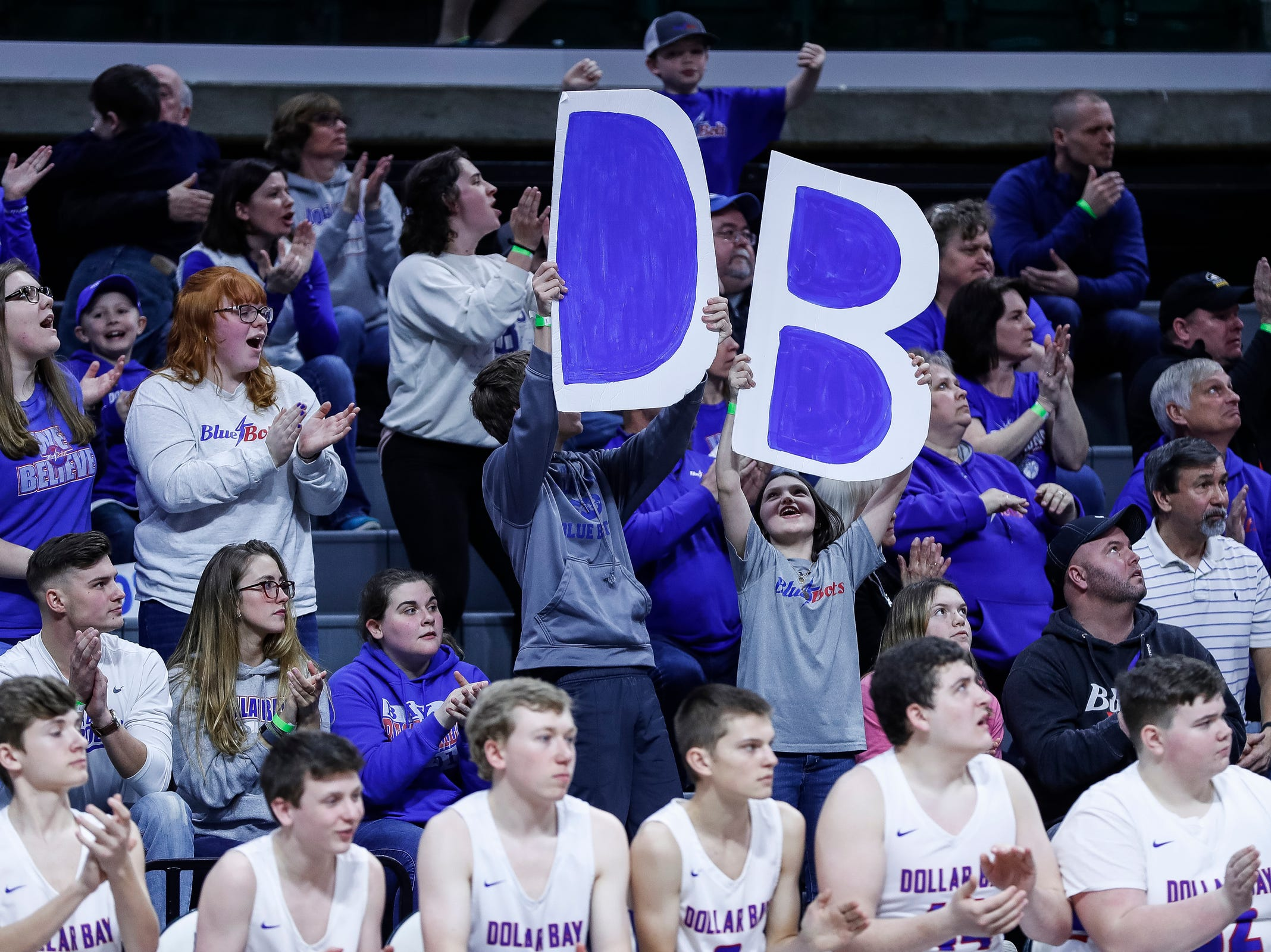 Dollar Bay fans cheer for the Blue Bolts during the first half of MHSAA Division 4 semifinal against Southfield Christian at the Breslin Center in East Lansing, Thursday, March 14, 2019.