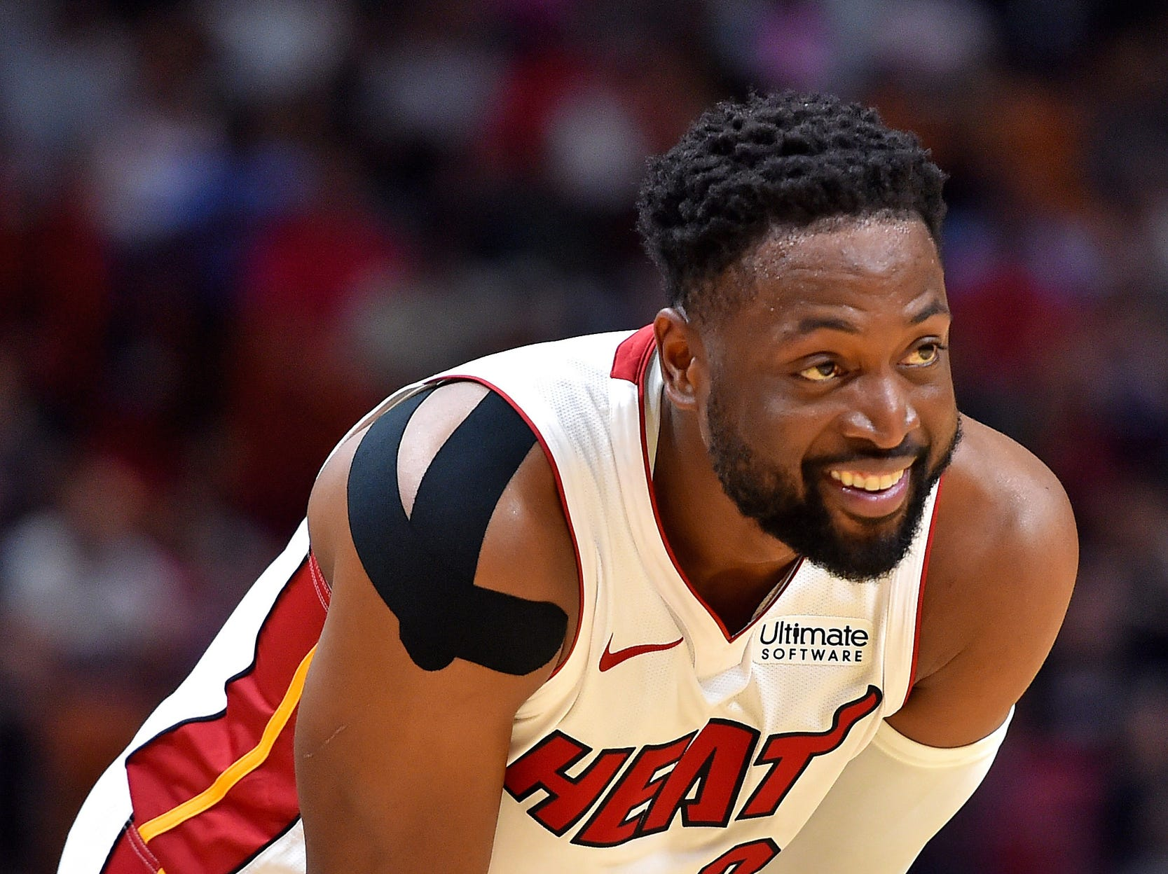 Miami Heat guard Dwyane Wade (3) smiles while taking a breather against the Detroit Pistons during the second half at American Airlines Arena on Wednesday, March 13, 2019.