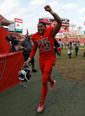 Buccaneers defensive back Andrew Adams runs off the field after the defeating the Panthers, Dec. 2, 2018, in Tampa, Fla.