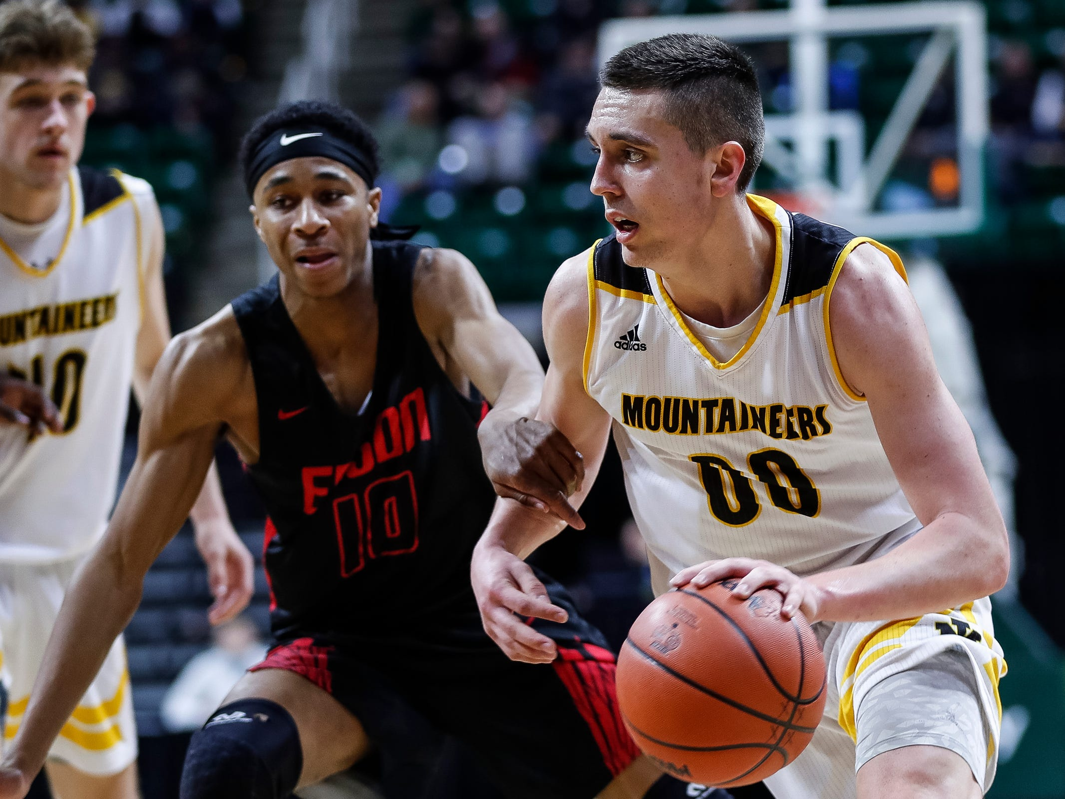 Iron Mountain's Foster Wonders dribbles against Detroit Edison's Ralph Bland during the first half of MHSAA Division 3 semifinal at the Breslin Center in East Lansing, Thursday, March 14, 2019.