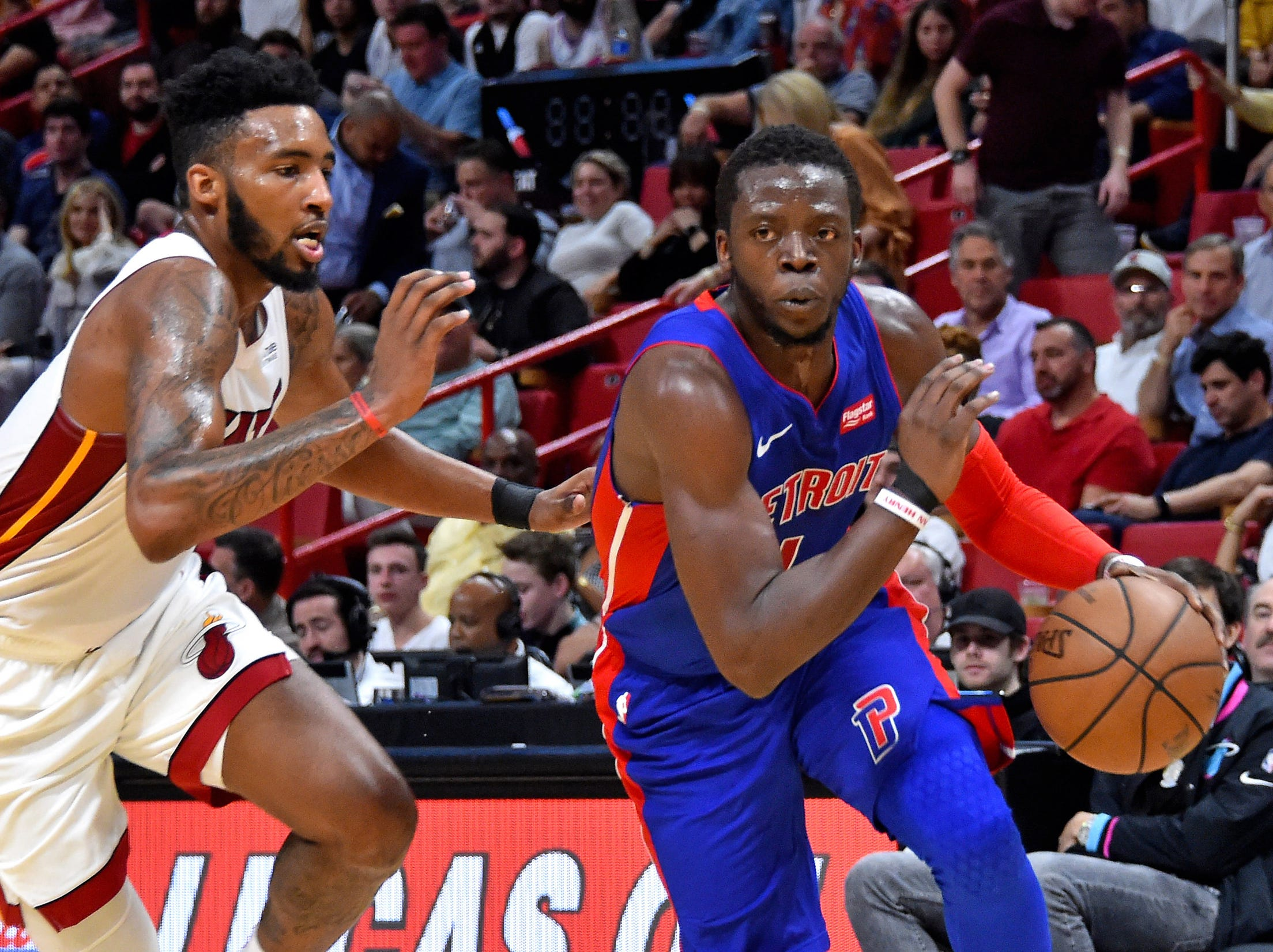 Detroit Pistons guard Reggie Jackson (1) drives to the basket as Miami Heat forward Derrick Jones Jr. (5) defends during the second half at American Airlines Arena on Wednesday, March 13, 2019.