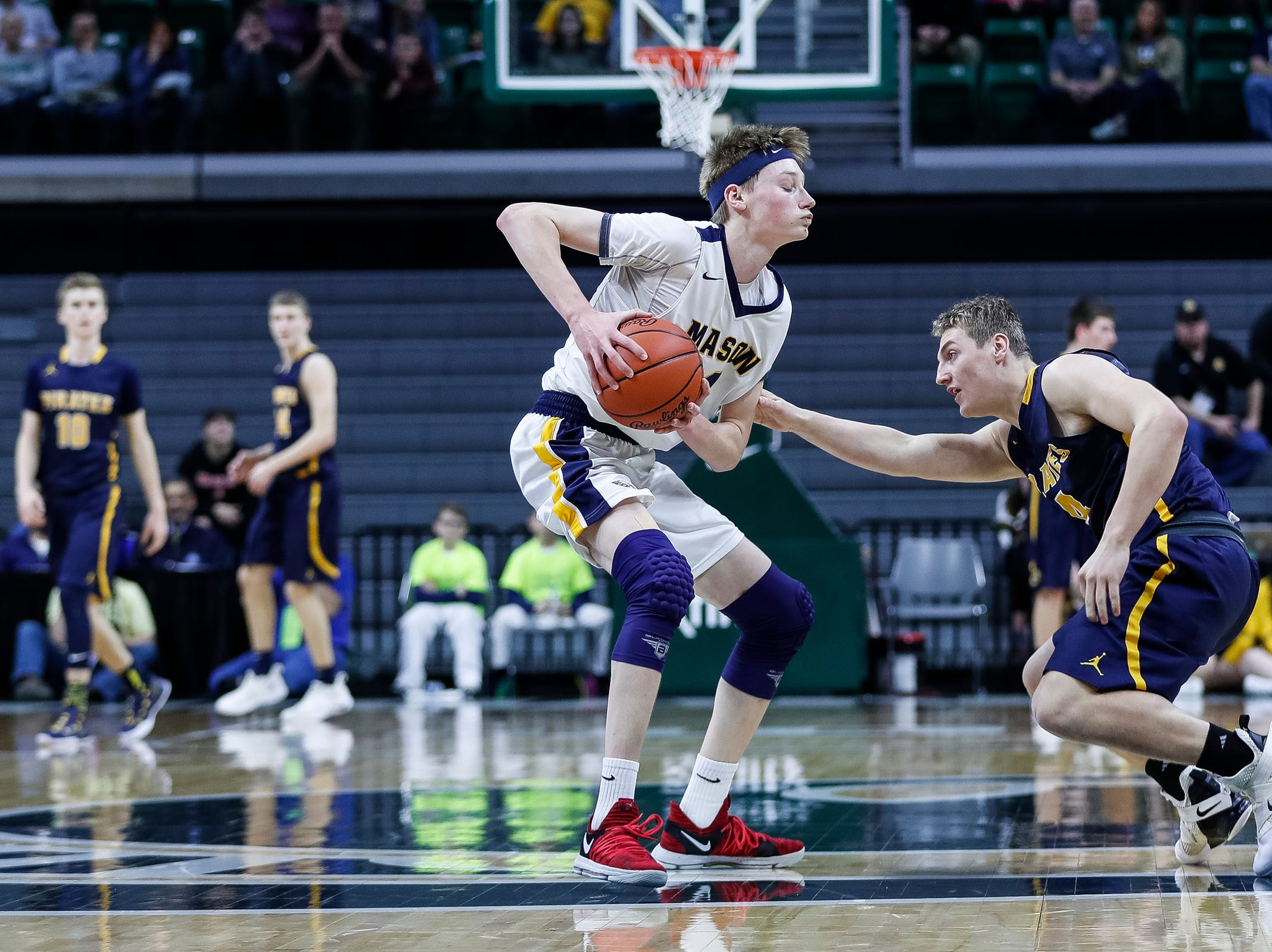 Pewamo-Westphalia's Jacob Pung (4) tries to steal the ball from Erie-Mason's John Sweeney (44) during the first half of MHSAA Division 3 semifinal at the Breslin Center in East Lansing, Thursday, March 14, 2019.
