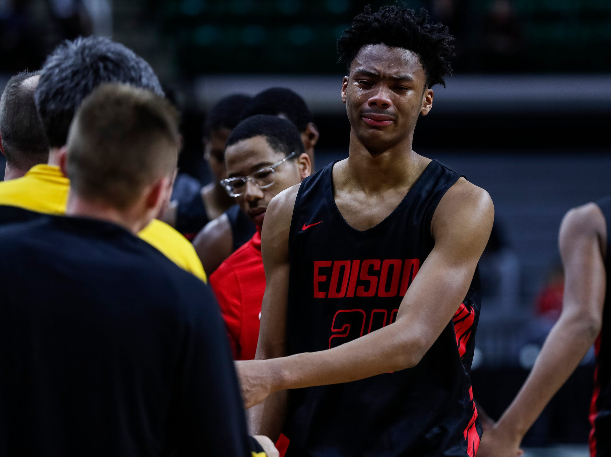 Detroit Edison's Dylan Bell (24) reacts to losing to Iron Mountain, 60-57, in the MHSAA Division 3 semifinal at Breslin Center in East Lansing on Thursday, March 14, 2019.