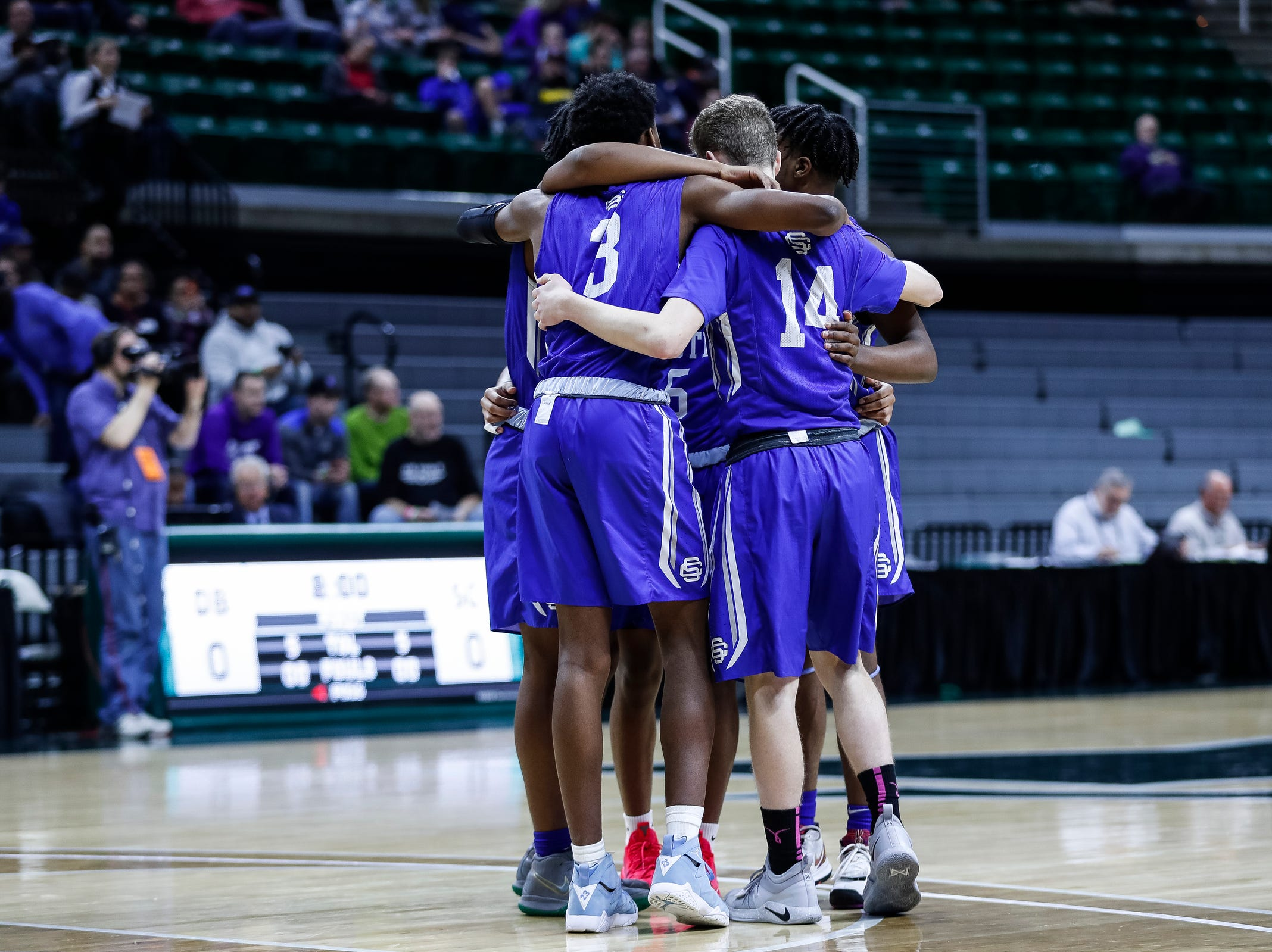 Southfield Christian players huddle before the first half of MHSAA Division 4 semifinal against Dollar Bay at the Breslin Center in East Lansing, Thursday, March 14, 2019.