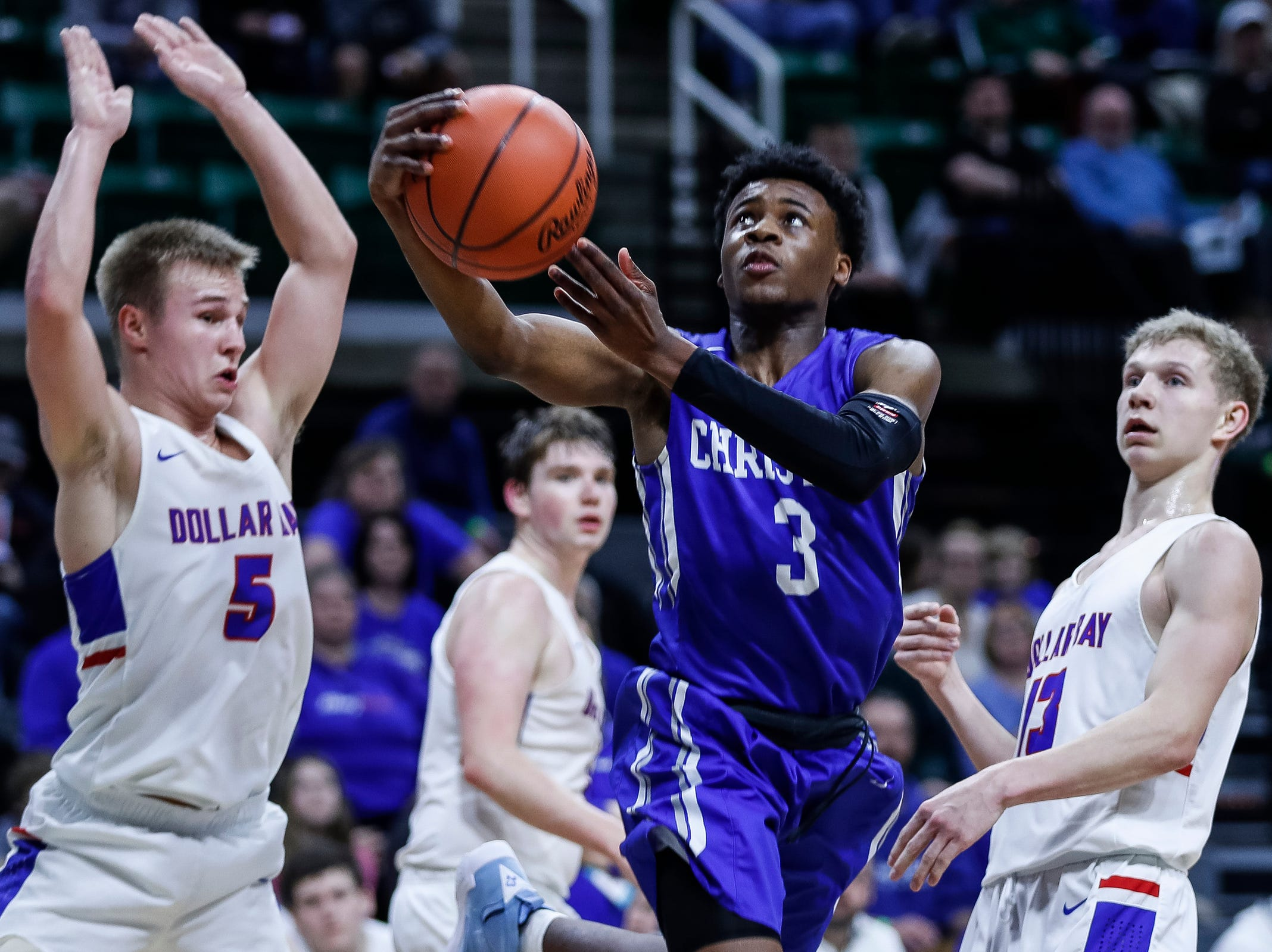 Southfield Christian's Da'Jion Humphrey (3) makes a layup against Dollar Bay's Brendan LeClaire (5) during the first half of MHSAA Division 4 semifinal at the Breslin Center in East Lansing, Thursday, March 14, 2019.