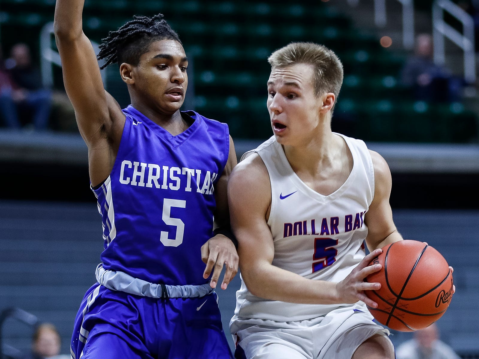 Southfield Christian's Verian Patrick (5) defends Dollar Bay's Brendan LeClaire (5) during the first half of MHSAA Division 4 semifinal at the Breslin Center in East Lansing, Thursday, March 14, 2019.