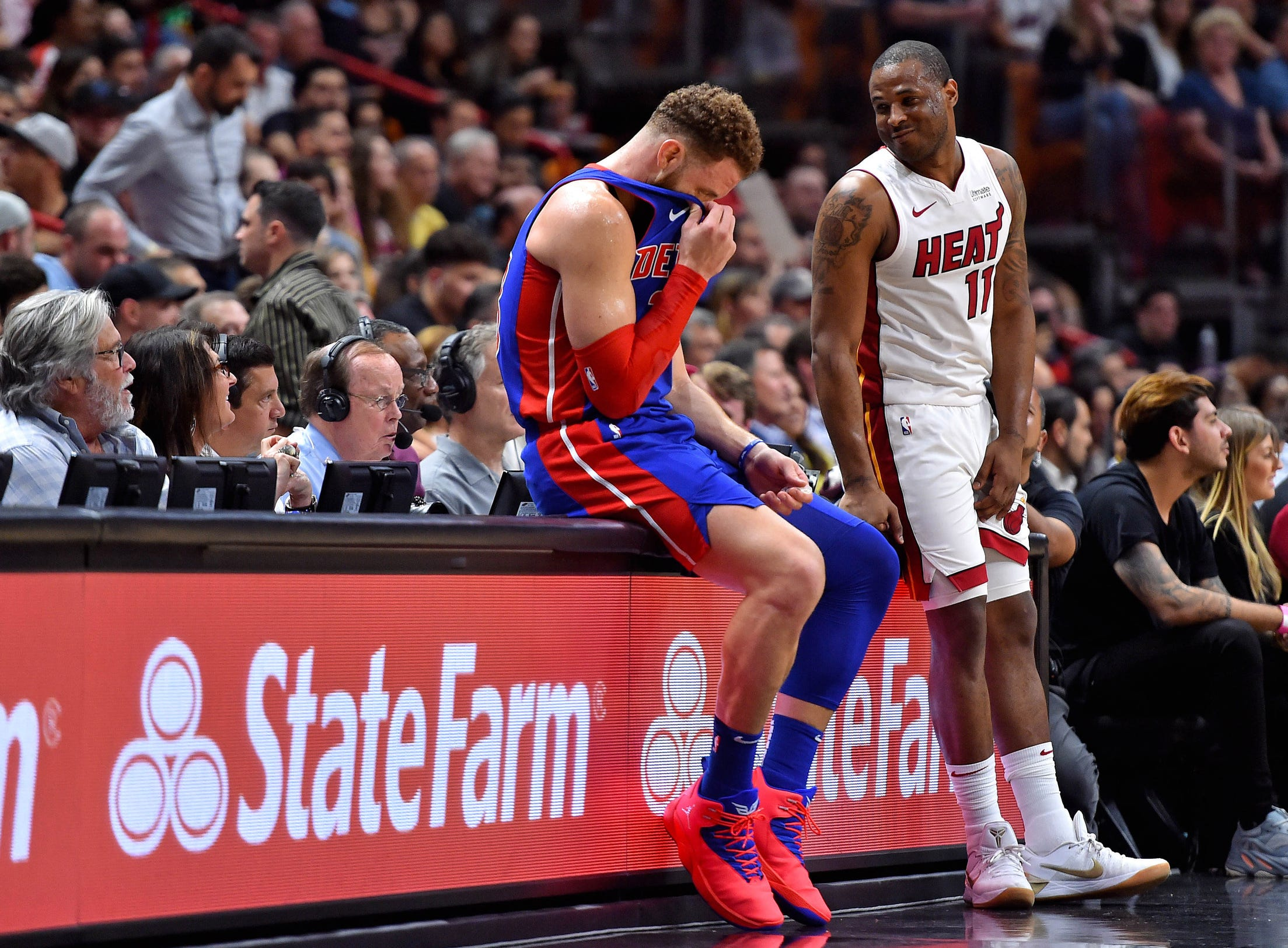 Miami Heat guard Dion Waiters (right) talks with Detroit Pistons forward Blake Griffin (left) during the second half at American Airlines Arena on Wednesday, March 13, 2019.