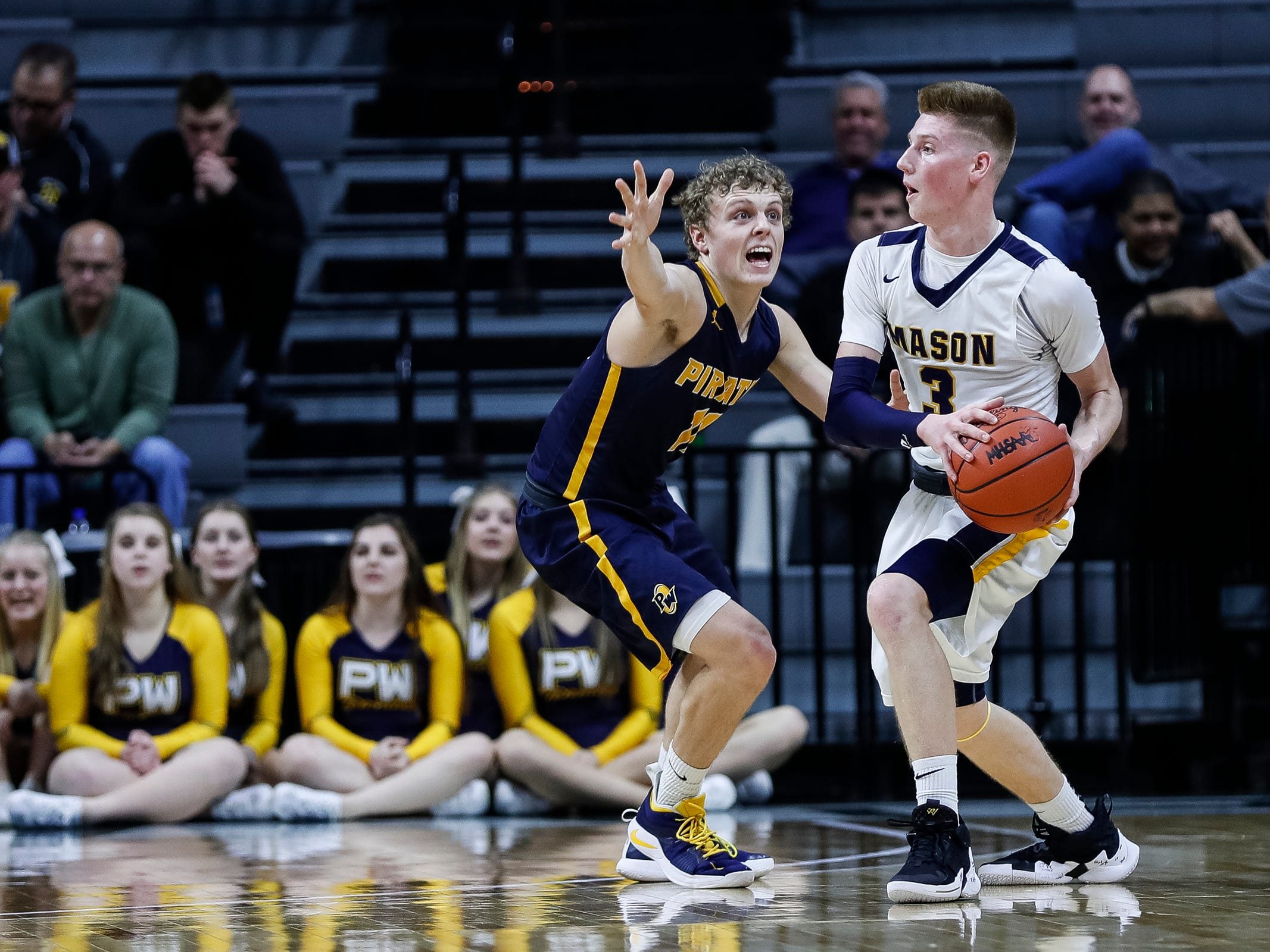 Erie-Mason's Jake Trainor (3) is defended by Pewamo-Westphalia's Collin Trierweiler (11) during the first half of MHSAA Division 3 semifinal at the Breslin Center in East Lansing, Thursday, March 14, 2019.