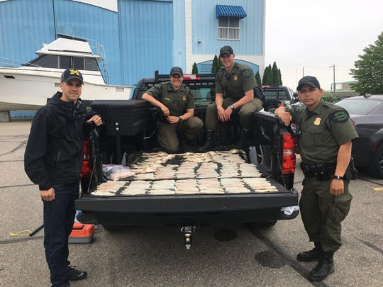 Conservation Officers David Schaumburger, Danielle Zubek, Adam Beuthin and Keven Luther caught two men poaching walleye from the Detroit River in May. The fresh, unfrozen fillets totaled 75 walleye – the poachers were over the legal limit by 65 fish. Officers located and arrested the poachers last week for failing to appear in court and pay their fines./