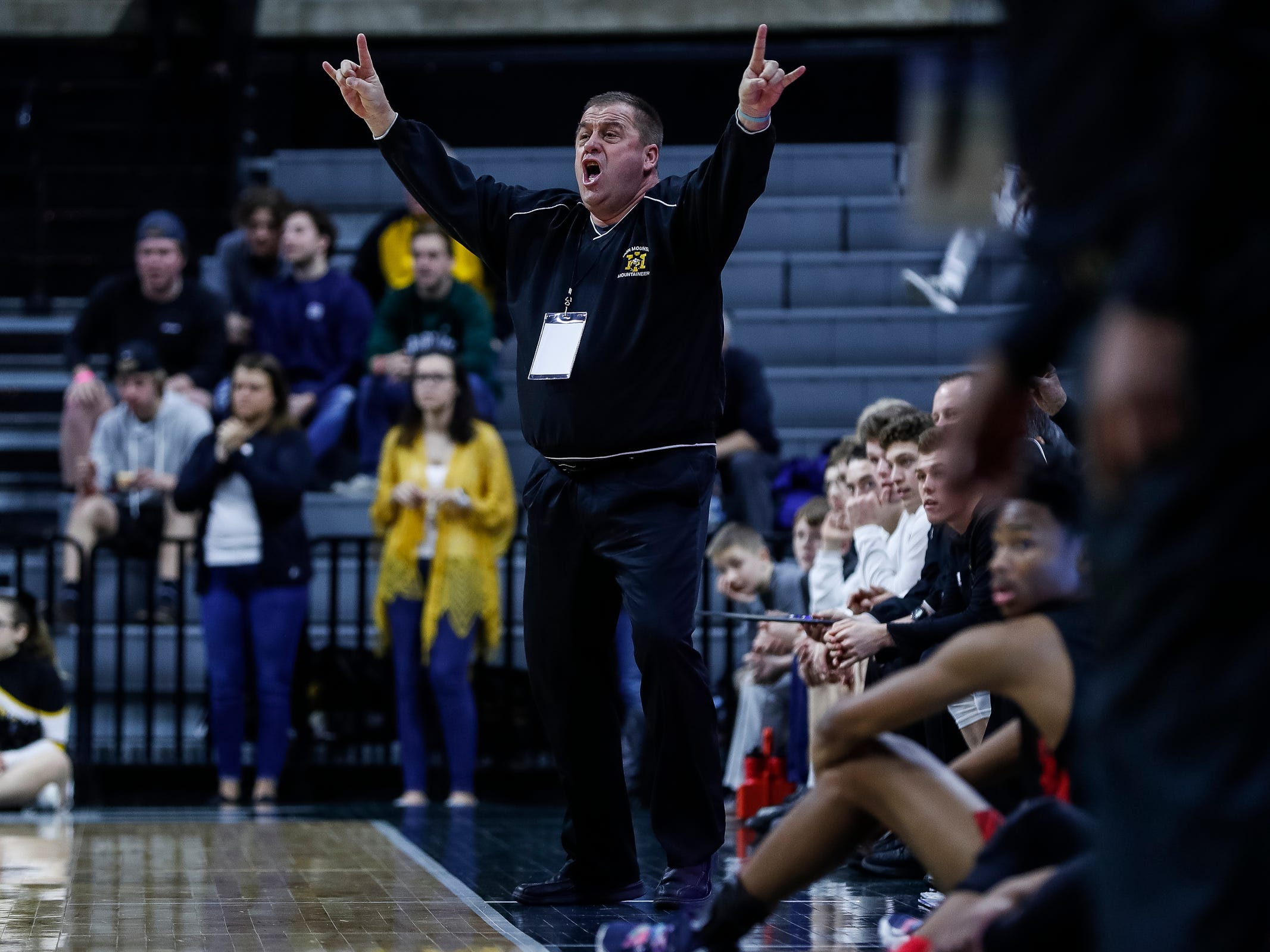 Iron Mountain head coach Harvey Johnson Jr. reacts to a play against Detroit Edison during the first half of MHSAA Division 3 semifinal at the Breslin Center in East Lansing, Thursday, March 14, 2019.