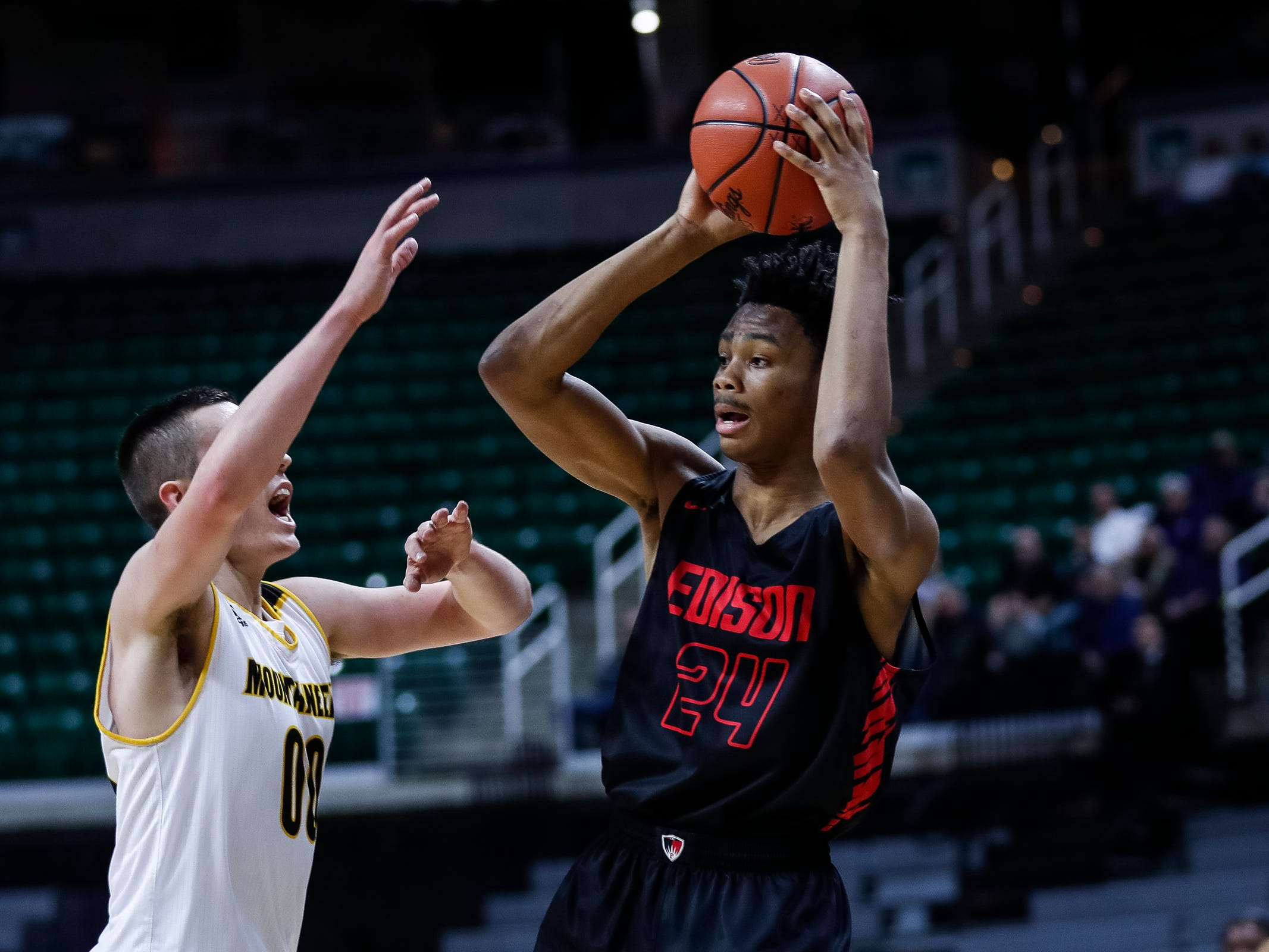 Detroit Edison's Dylan Bell looks to pass against Iron Mountain during the first half of MHSAA Division 3 semifinal at the Breslin Center in East Lansing, Thursday, March 14, 2019.