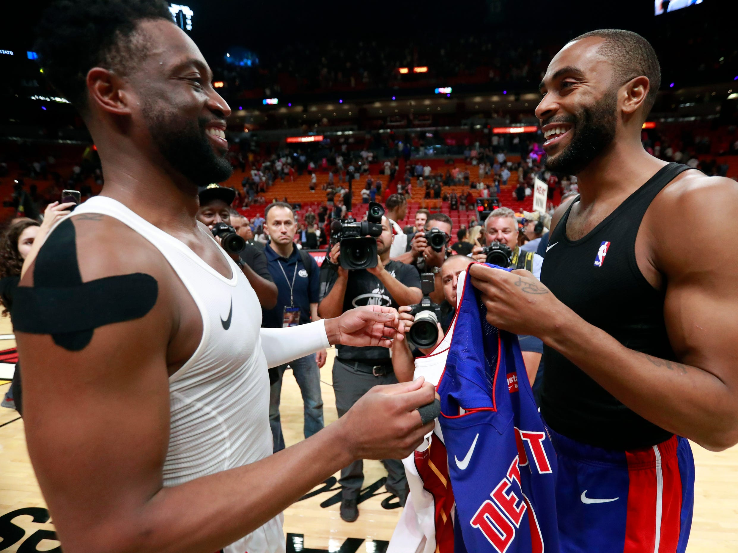 Miami Heat guard Dwyane Wade, left, and Detroit Pistons guard Wayne Ellington smile as they exchange jerseys after an NBA basketball game, Wednesday, March 13, 2019, in Miami. The Heat defeated the Pistons 108-74.
