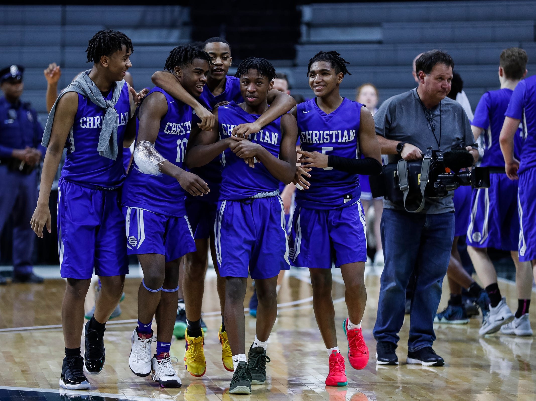 Southfield Christian players celebrate their 55-28 victory over Dollar Bay at the MHSAA Division 4 semifinal at the Breslin Center in East Lansing, Thursday, March 14, 2019.