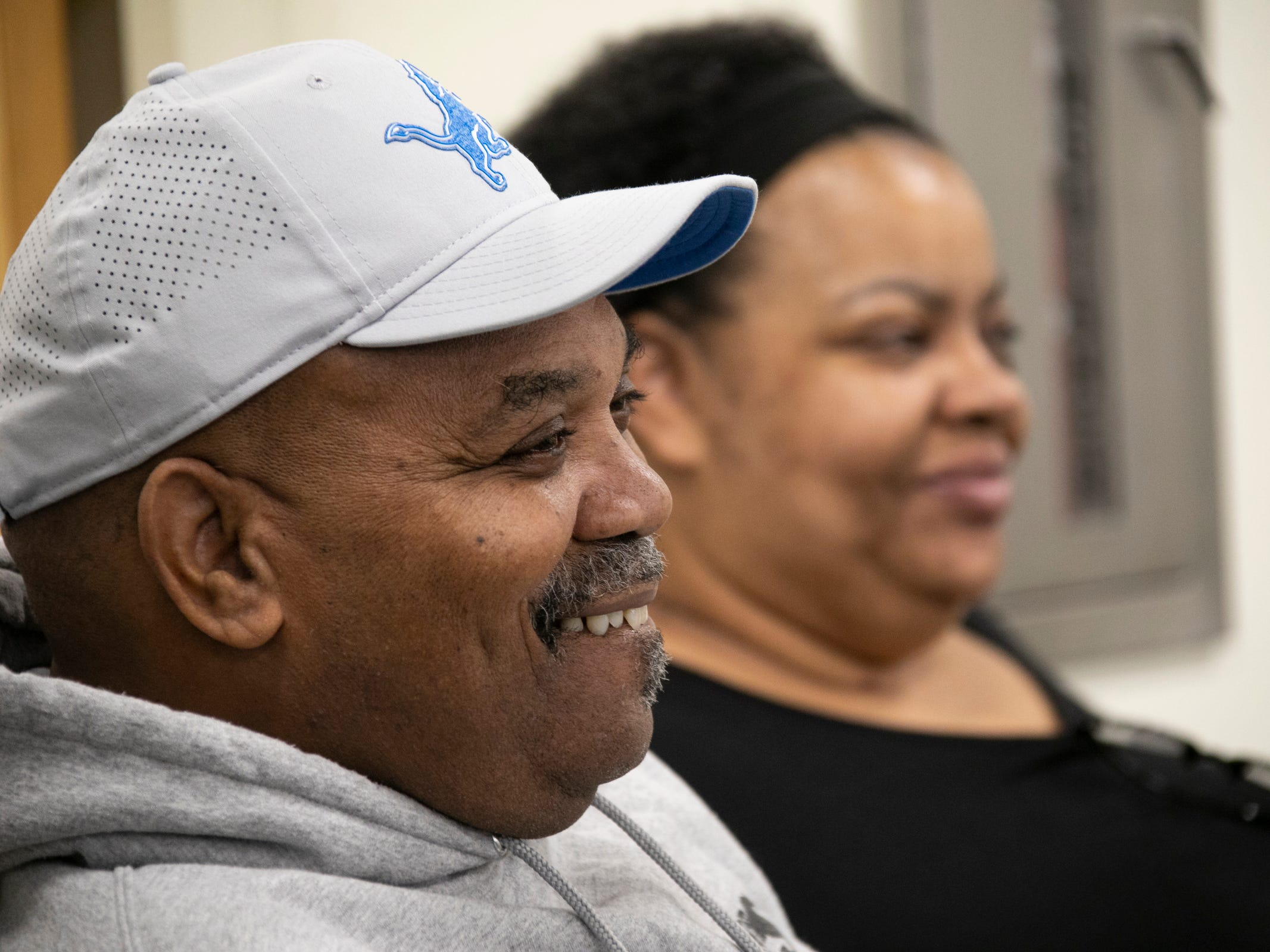 Robert and Jaqueline Flowers look on as their son, Trey Flowers, the newly signed defensive end for the Detroit Lions, speaks to the media Thursday, March 14, 2019 at the practice facility in Allen Park.