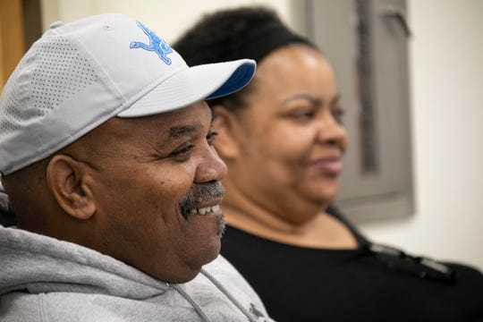 Robert and Jaqueline Flowers look on as their son, Trey, speaks to the media Thursday at the Lions practice facility.