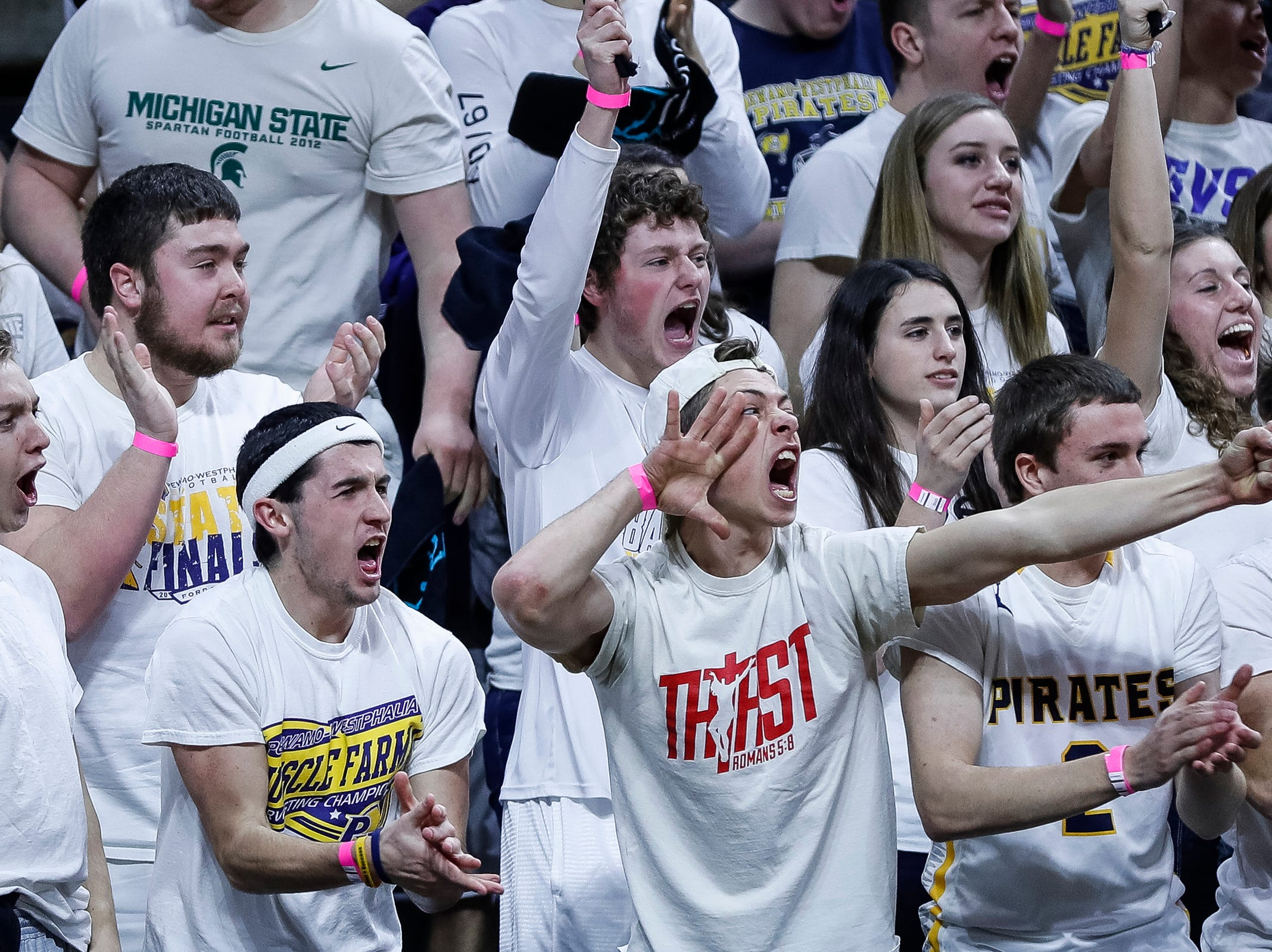 Pewamo-Westphalia fans cheer for the Pirates against Erie-Mason during the first half of MHSAA Division 3 semifinal at the Breslin Center in East Lansing, Thursday, March 14, 2019.