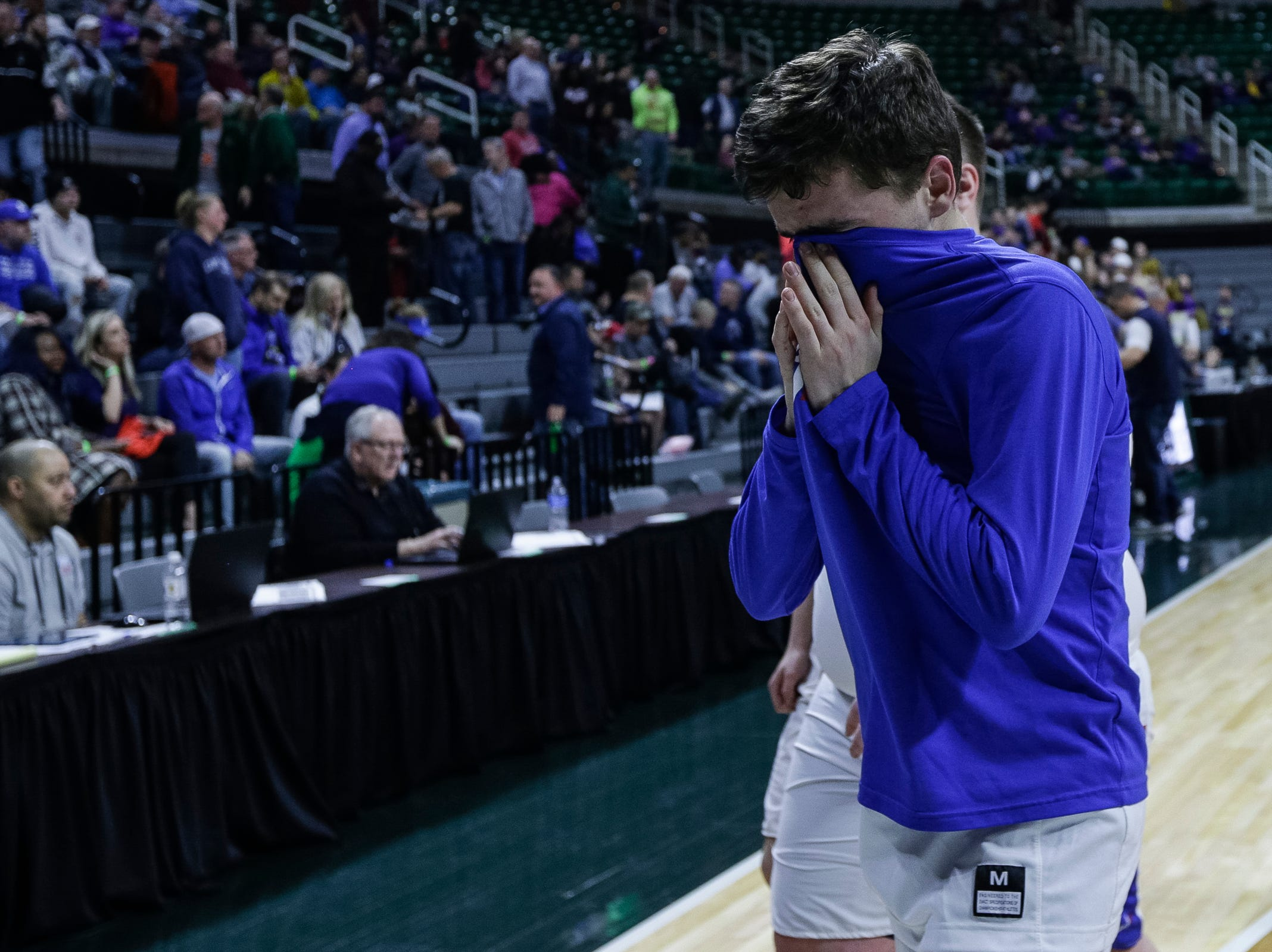 Dollar Bay players walk off the court after losing to Southfield Christian 55-28 at the MHSAA Division 4 semifinal at the Breslin Center in East Lansing, Thursday, March 14, 2019.