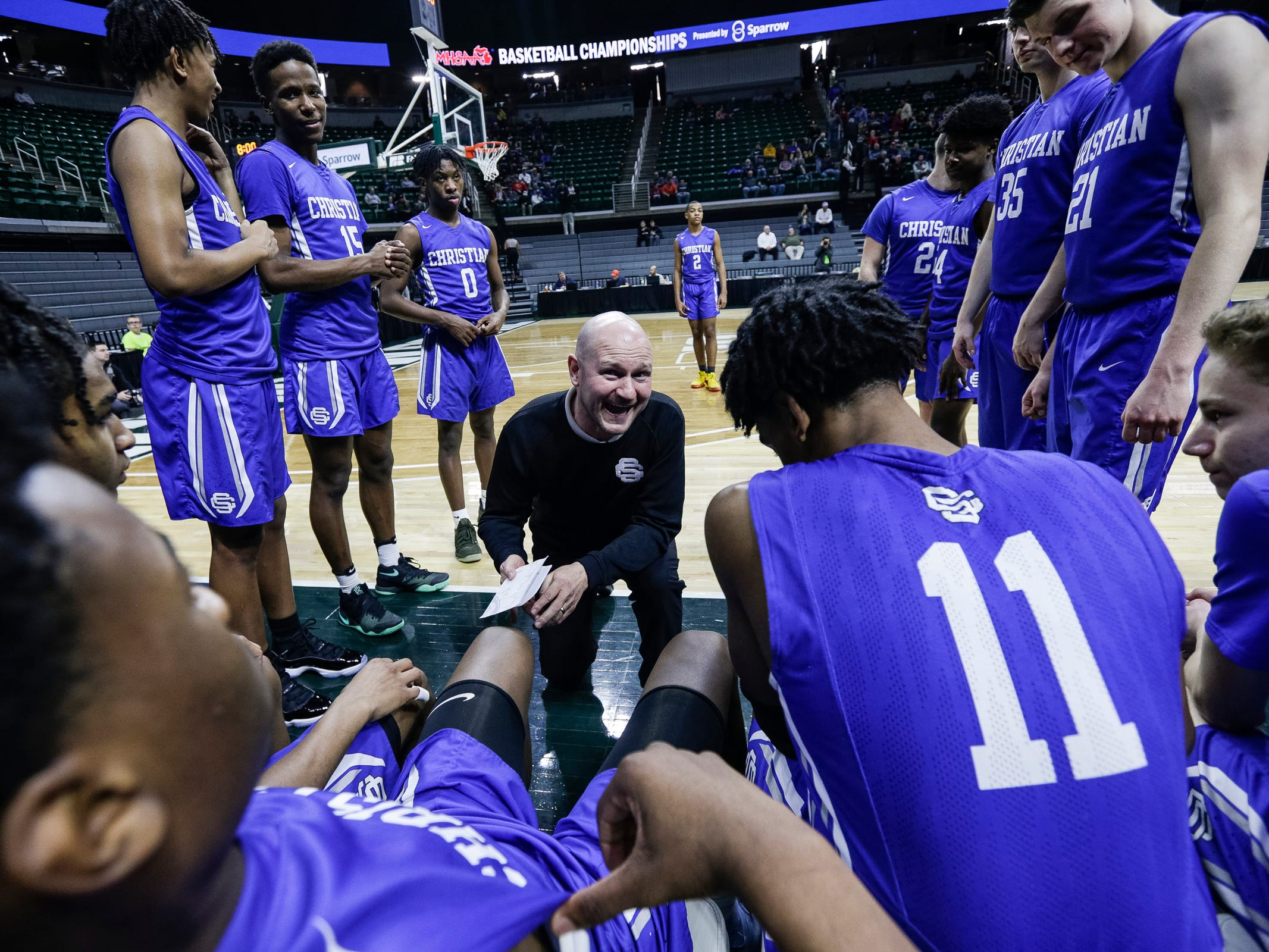 Southfield Christian head coach Josh Baker gives a speech to players before the MHSAA Division 4 semifinal against Dollar Bay at the Breslin Center in East Lansing, Thursday, March 14, 2019.