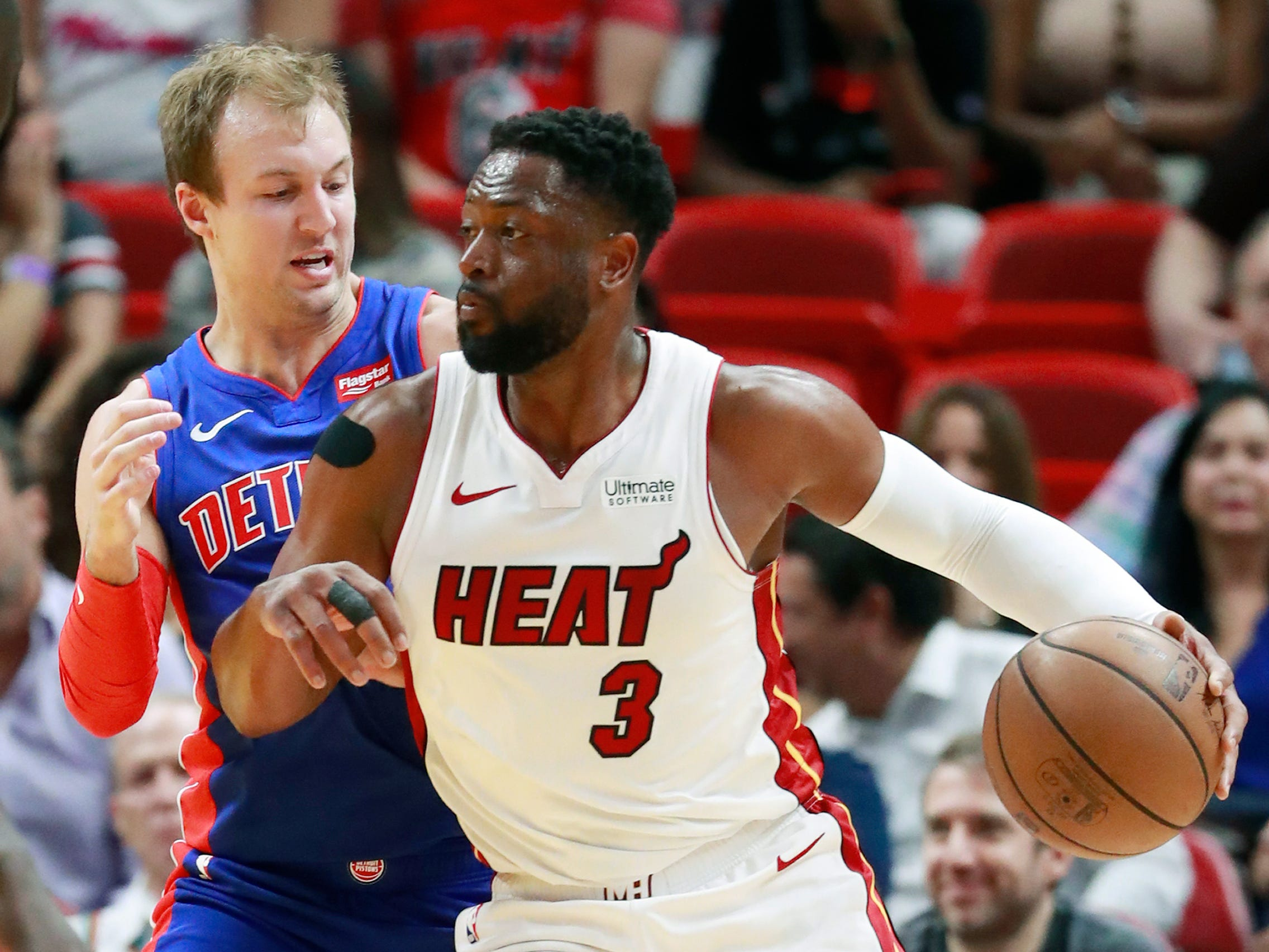 Miami Heat guard Dwyane Wade (3) drives against Detroit Pistons guard Luke Kennard during the first half of an NBA basketball game, Wednesday, March 13, 2019, in Miami.