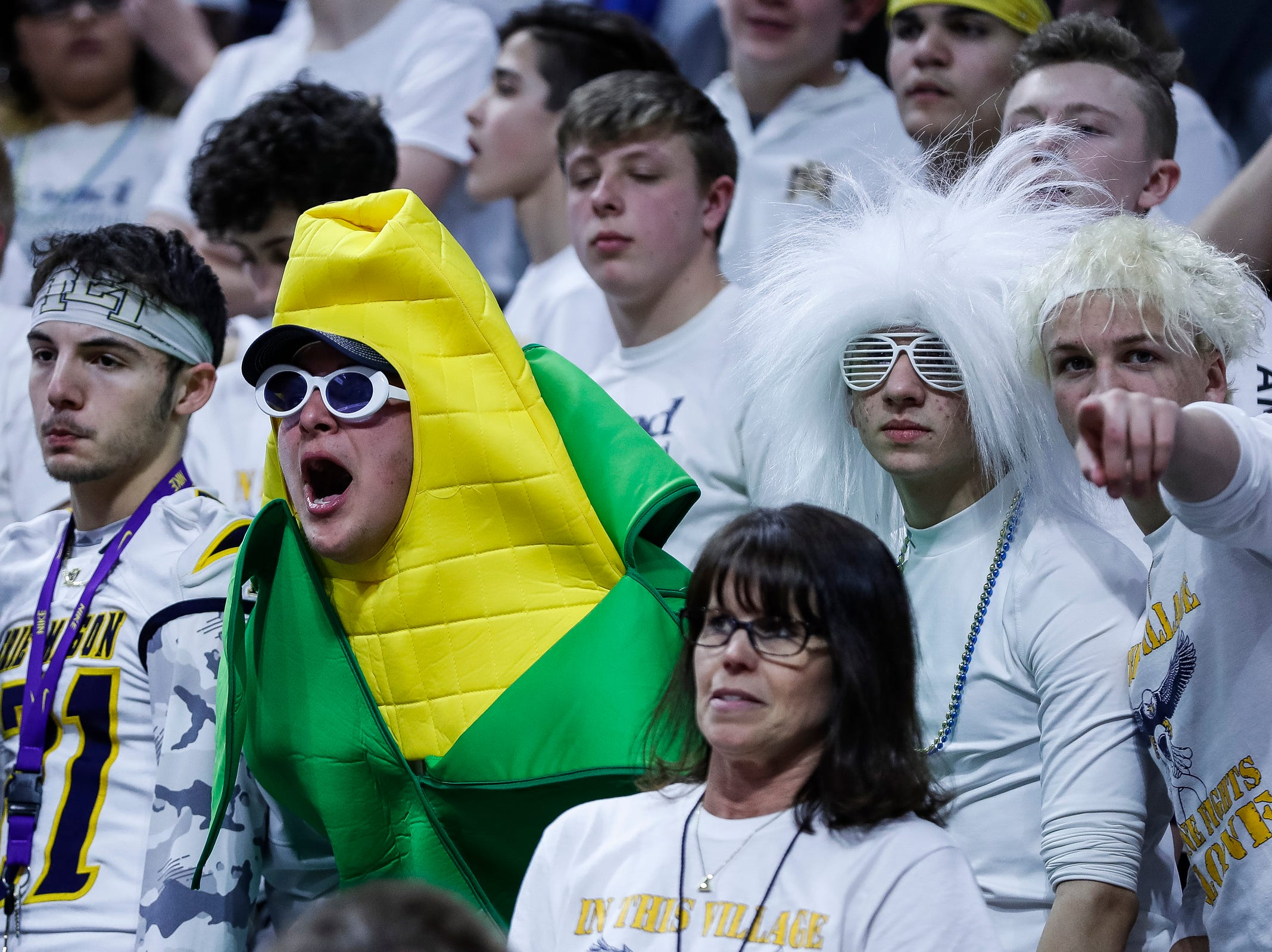 Erie-Mason fans cheer for the Eagles against Pewamo-Westphalia during the first half of MHSAA Division 3 semifinal at the Breslin Center in East Lansing, Thursday, March 14, 2019.