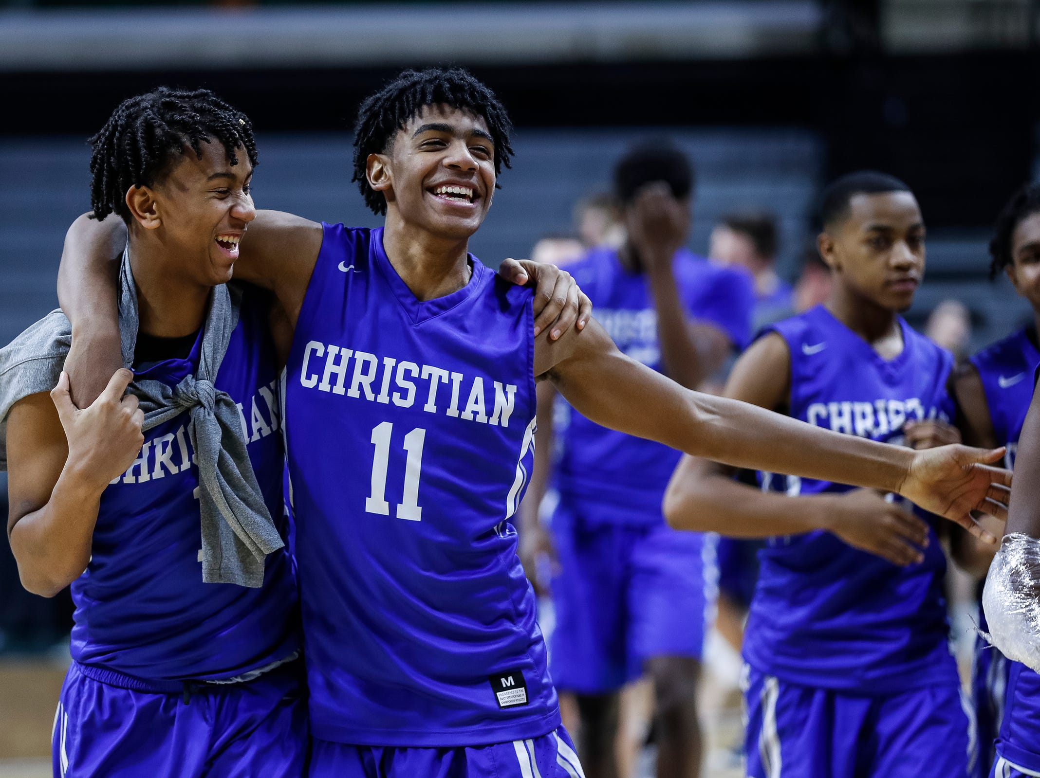 Southfield Christian's Tarron Carter (1) and Malcolm King (11) celebrates the Eagles' 55-28 victory over Dollar Bay at the MHSAA Division 4 semifinal at the Breslin Center in East Lansing, Thursday, March 14, 2019.