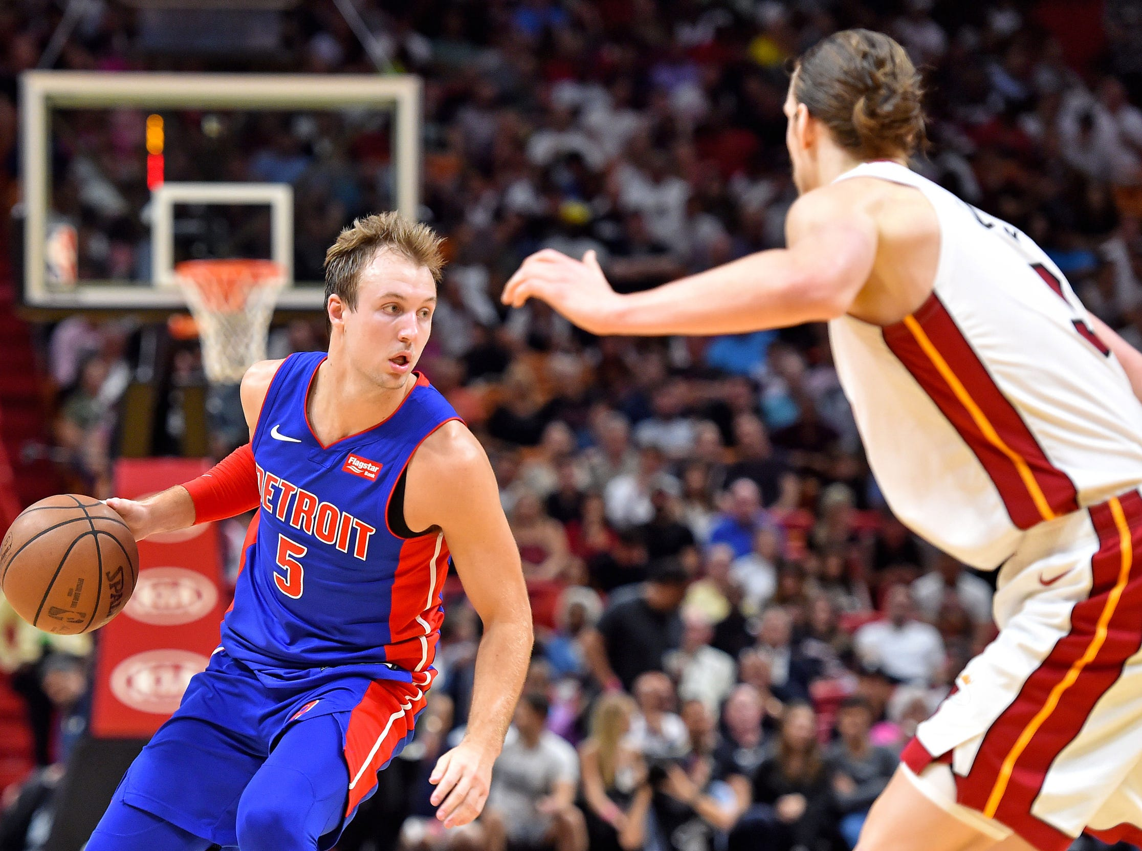 Miami Heat forward Kelly Olynyk (9) guards Detroit Pistons guard Luke Kennard (5) during the second half at American Airlines Arena on Wednesday, March 13, 2019.