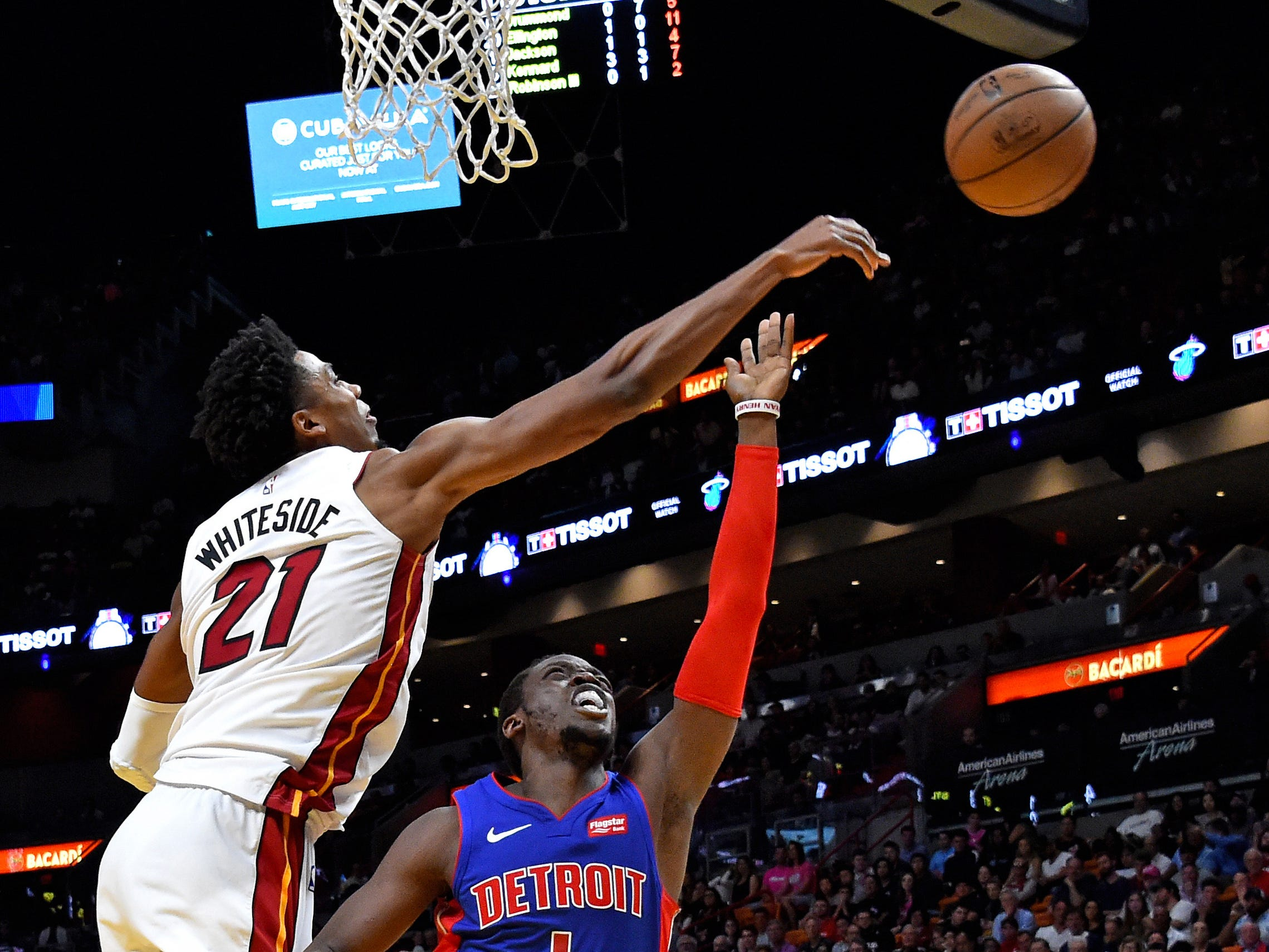Miami Heat center Hassan Whiteside (21) blocks the shot from Detroit Pistons guard Reggie Jackson (1) during the second half at American Airlines Arena on Wednesday, March 13, 2019.