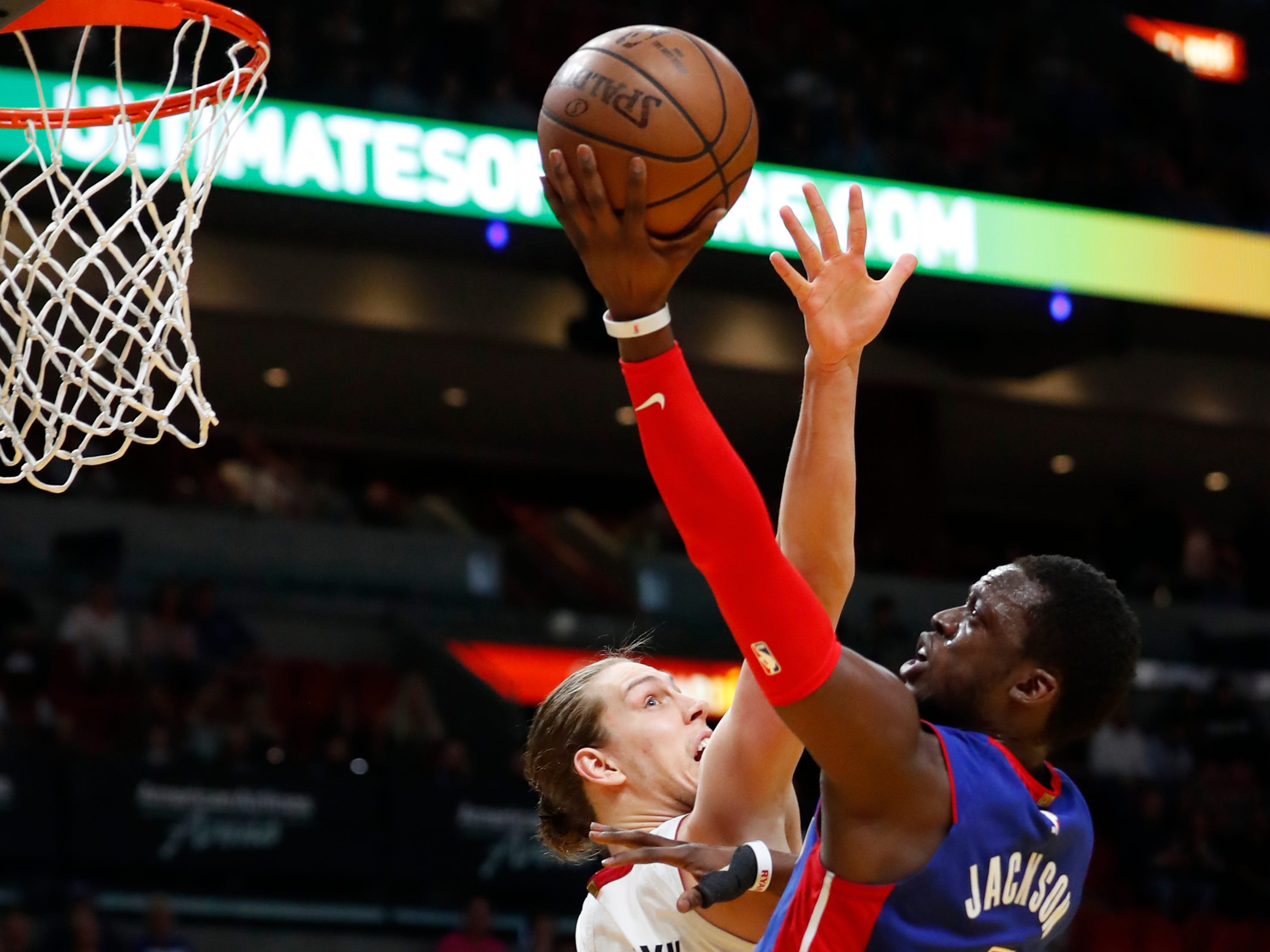 Detroit Pistons guard Reggie Jackson (1) shoots against Miami Heat forward Kelly Olynyk (9) during the first half.