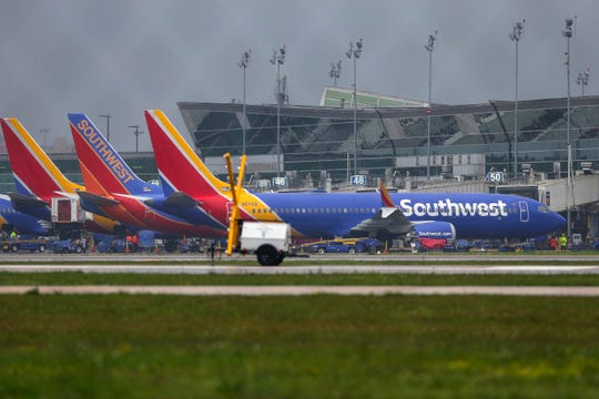 A Boeing 737 MAX 8 operated by Southwest Airlines sits at a gate at Hobby Airport after arriving Wednesday, March 13, 2019, in Houston.
