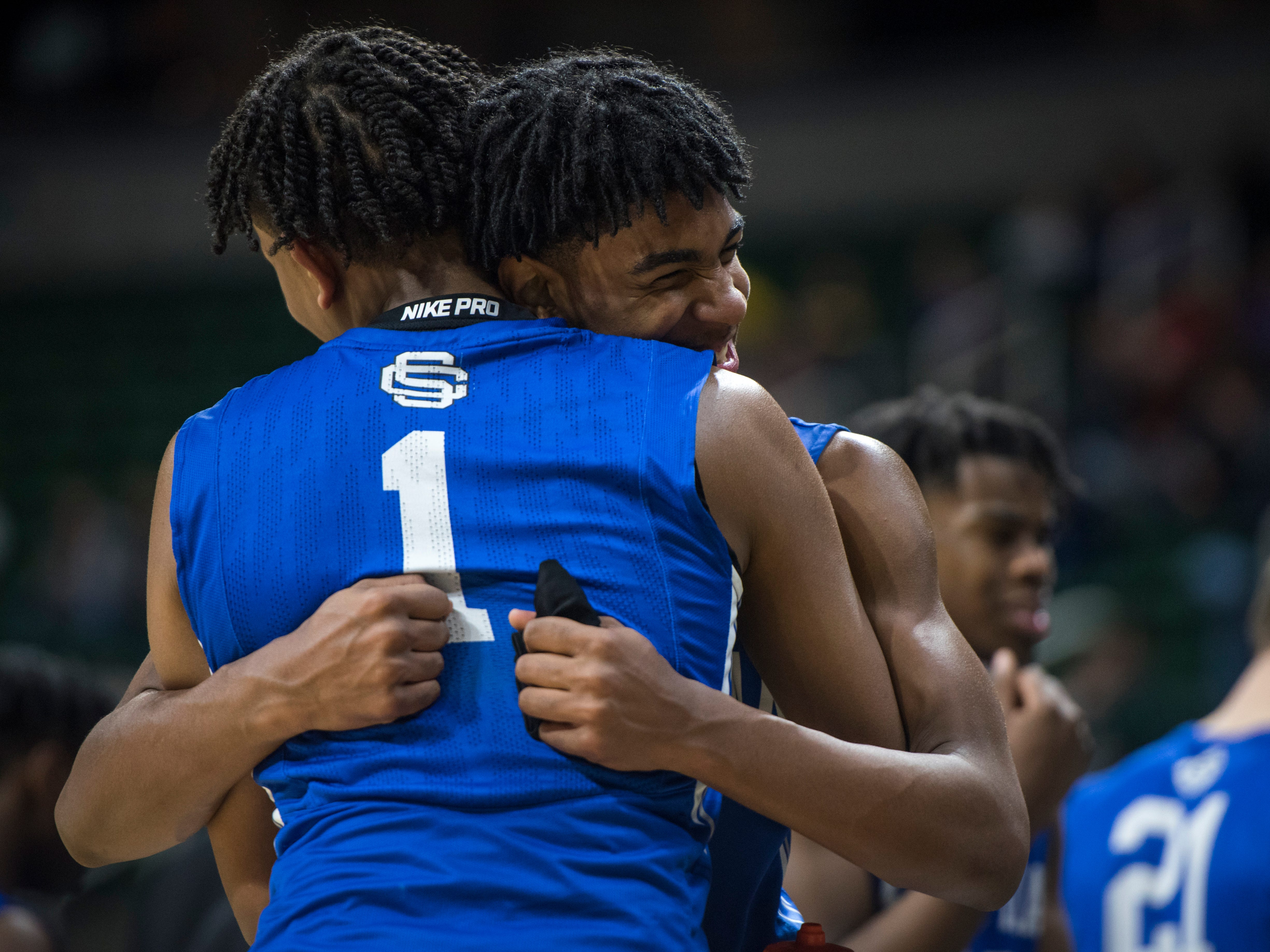 Southfield Christian's Tarron Carter, left, embraces Southfield Christian's Malcolm King in the second half.