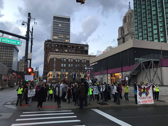 "Separated by police, a group of 50 protesters gathered across from Cobo Center Thursday chanting ""All the walls have got to go from Palestine to Mexico."""