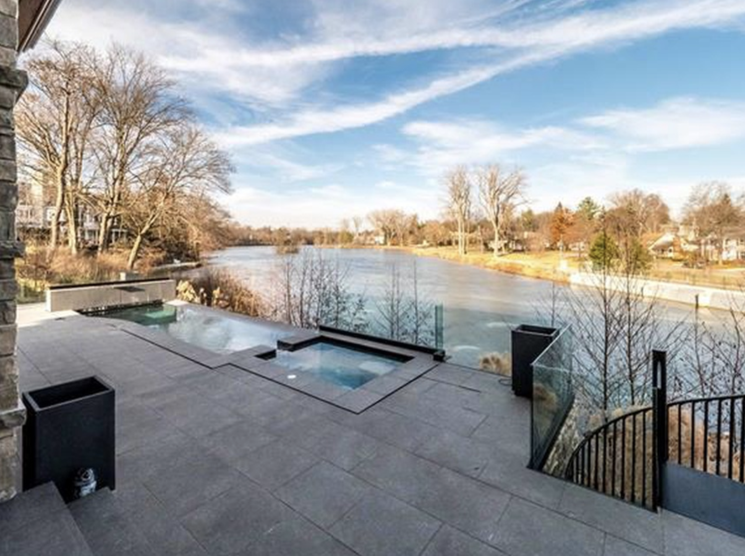 The home features an infinity edge pool, as well as overlooking a lake and a waterfall.