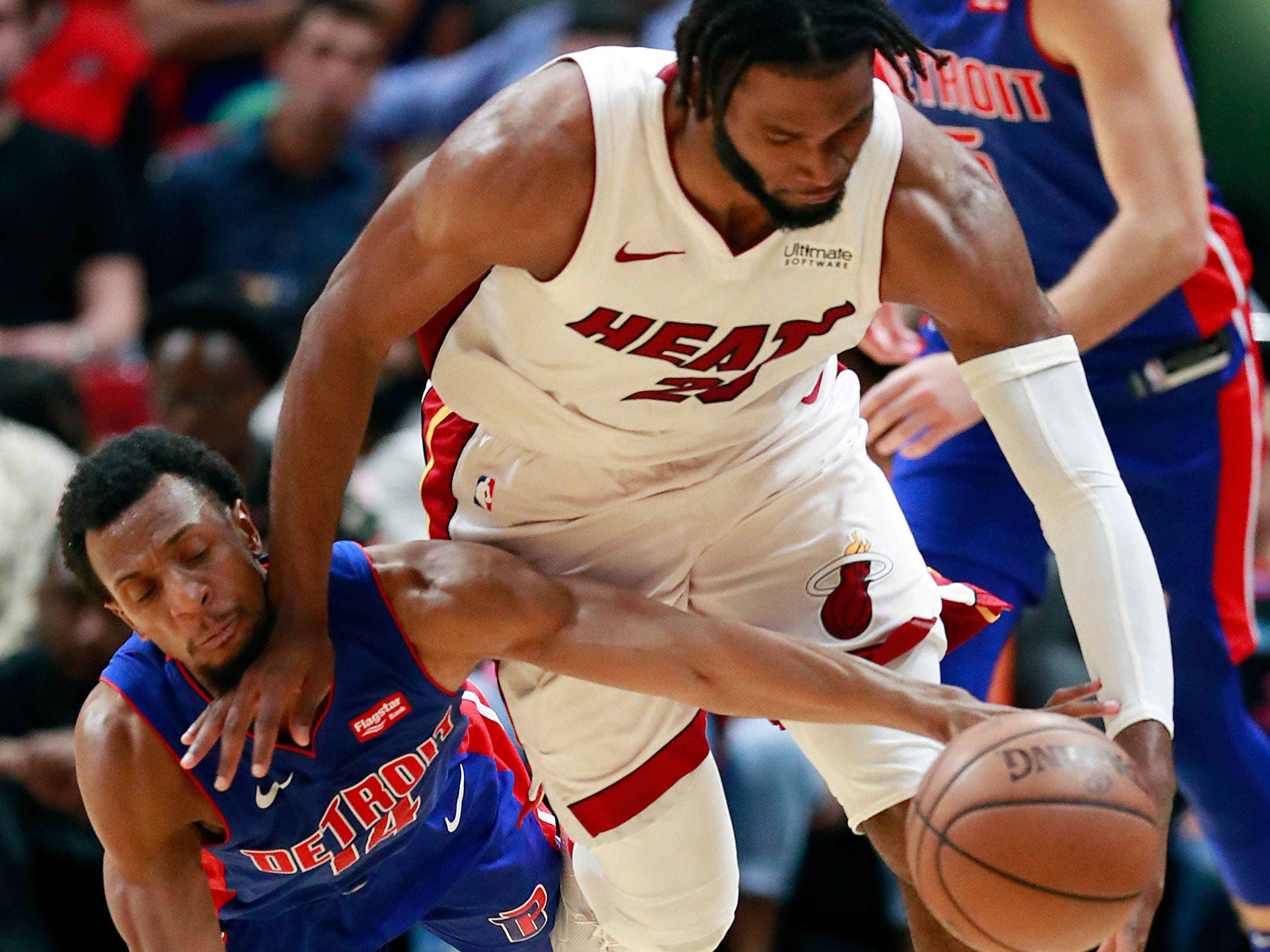 Miami Heat forward Justise Winslow, right, and Detroit Pistons guard Ish Smith battle for a loose ball during the second half.