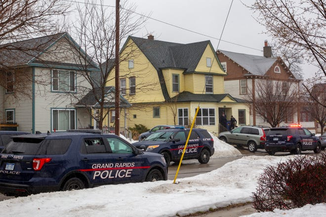 Grand Rapids Police arrive to investigate two suspicious deaths at a home in Grand Rapids, Mich, on Wednesday, March 13, 2019.