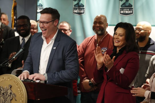 Fiat Chrysler Chief Operating Officer Mark Stewart stands with Gov. Gretchen Whitmer as he announces plans for Fiat Chrysler to build a new assembly plant in Detroit last month.