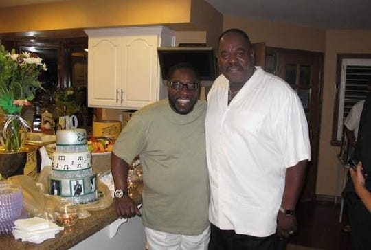The O'Jays lead singer Eddie Levert, left, and the late UAW Vice President General Holiefield at Levert's home near Las Vegas in 2012.