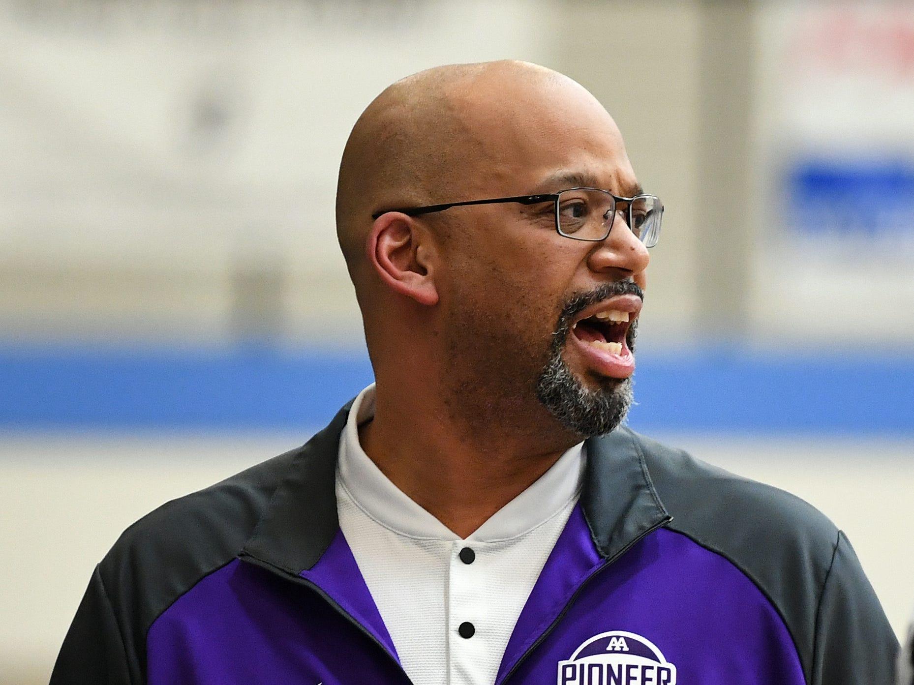 Ann Arbor Pioneer girls basketball head coach Tyrone Hicks watches his team play against Wayne Memorial in the first quarter.