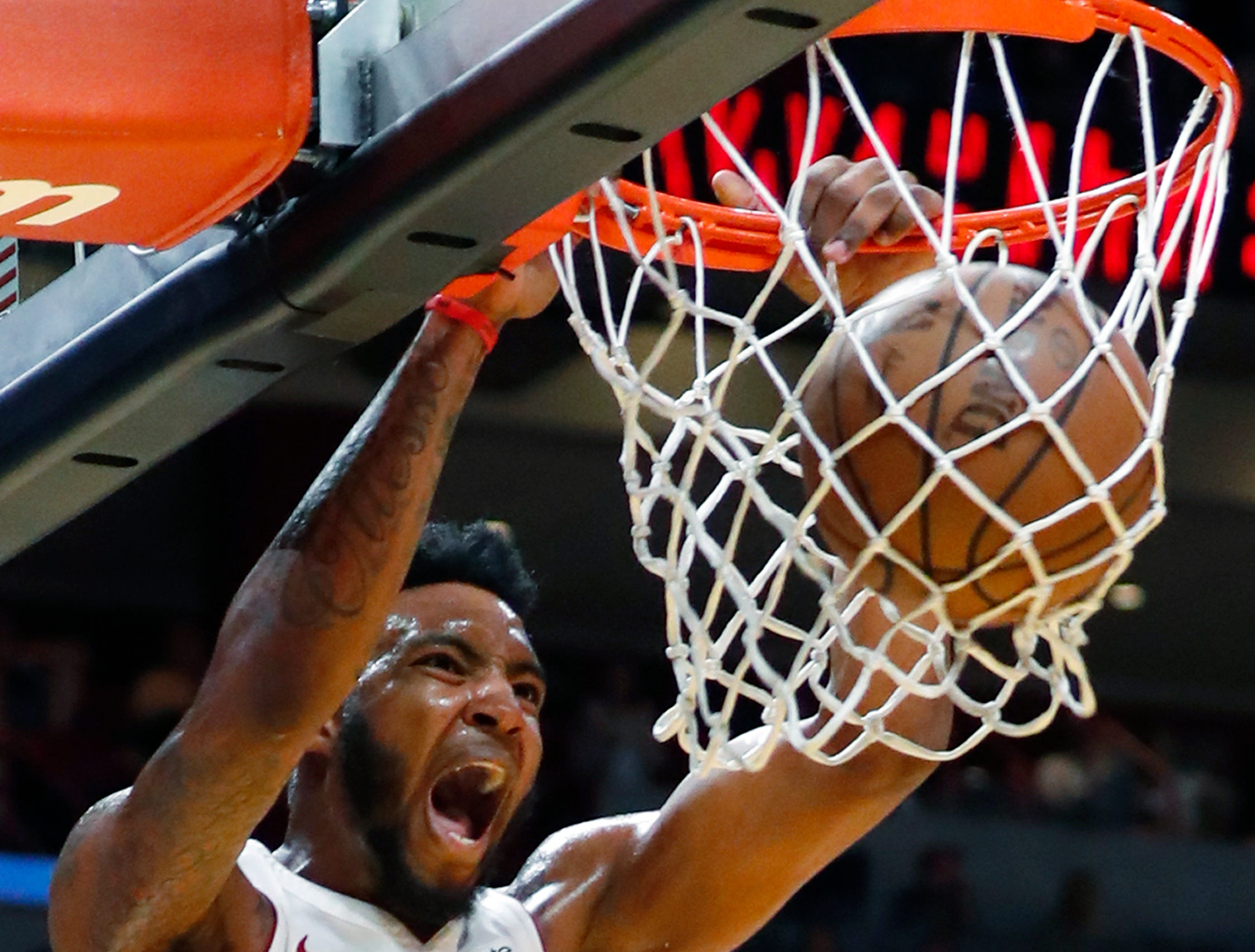 Miami Heat forward Derrick Jones Jr. dunks the ball during the second half.