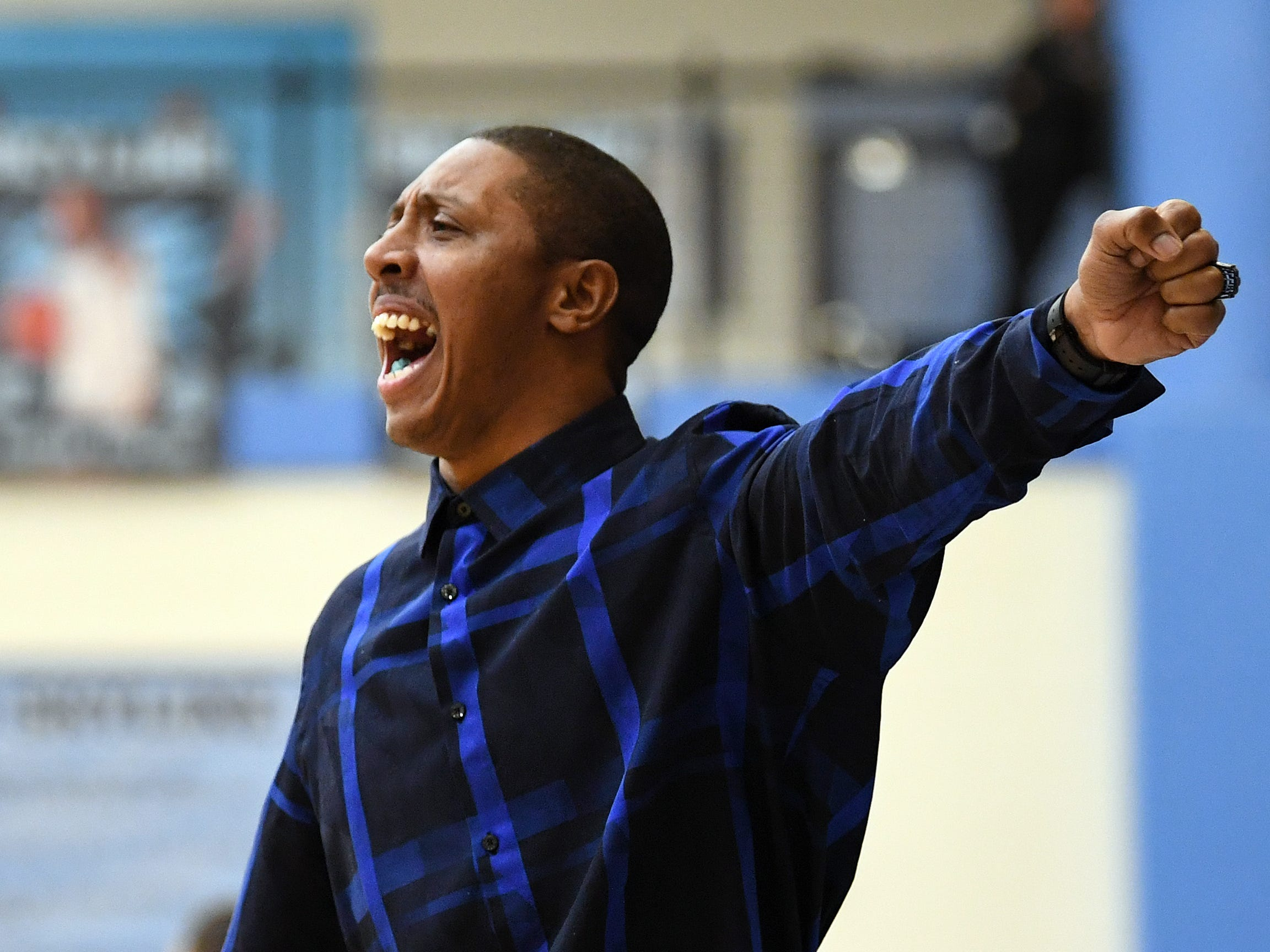 Wayne Memorial girls basketball head coach Jarvis Mitchell yells instructions to his team as they played against Ann Arbor Pioneer in the first quarter.