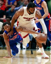Miami Heat forward Justise Winslow and Detroit Pistons guard Ish Smith battle for a loose ball during the second half Wednesday night.