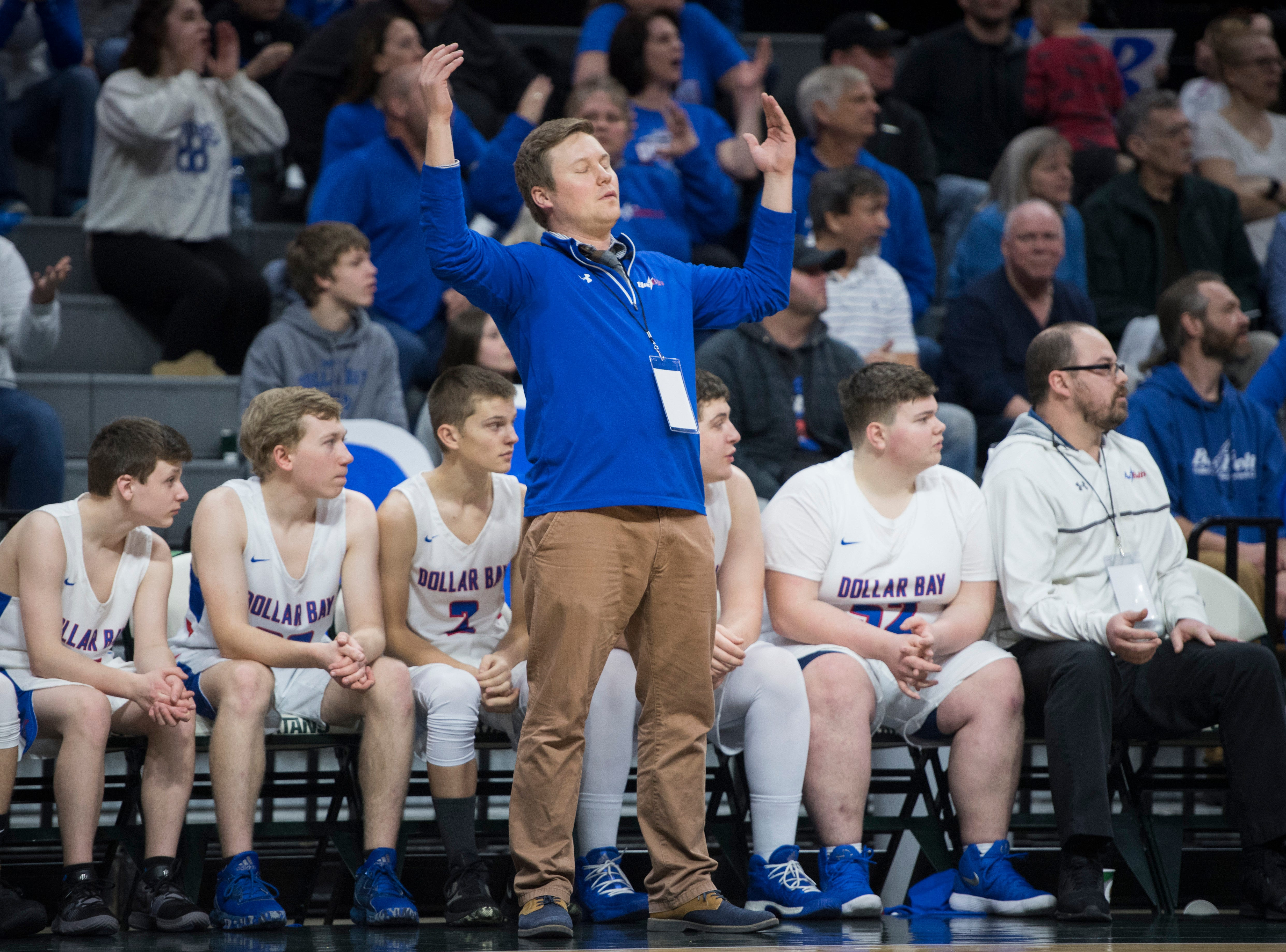 Dollar Bay's head coach Jesse Kentala reacts in the first half.