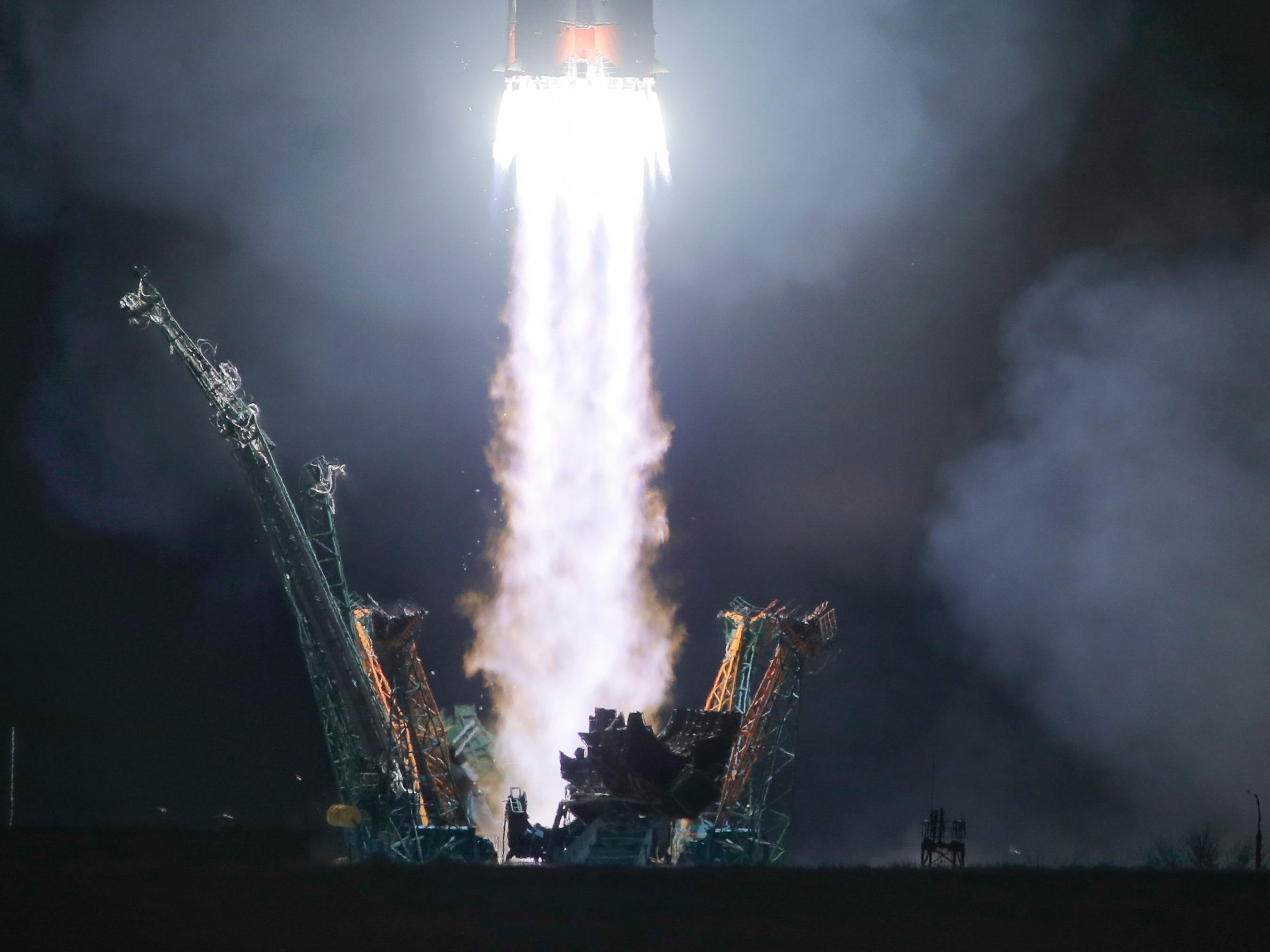 The Russian Soyuz rocket carrying NASA astronauts Nick Hague and Christina Koch along with cosmonaut Alexei Ovchinin lifts off from the Baikonur cosmodrome in Kazakhstan early Friday, March 15, 2019, bound for the International Space Station.