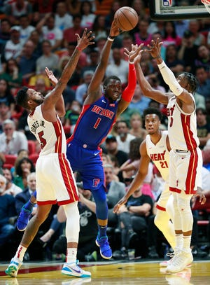 Detroit Pistons guard Reggie Jackson passes past Miami Heat forward Derrick Jones Jr. (5), center Hassan Whiteside (21) and guard Josh Richardson (0) during the second half.