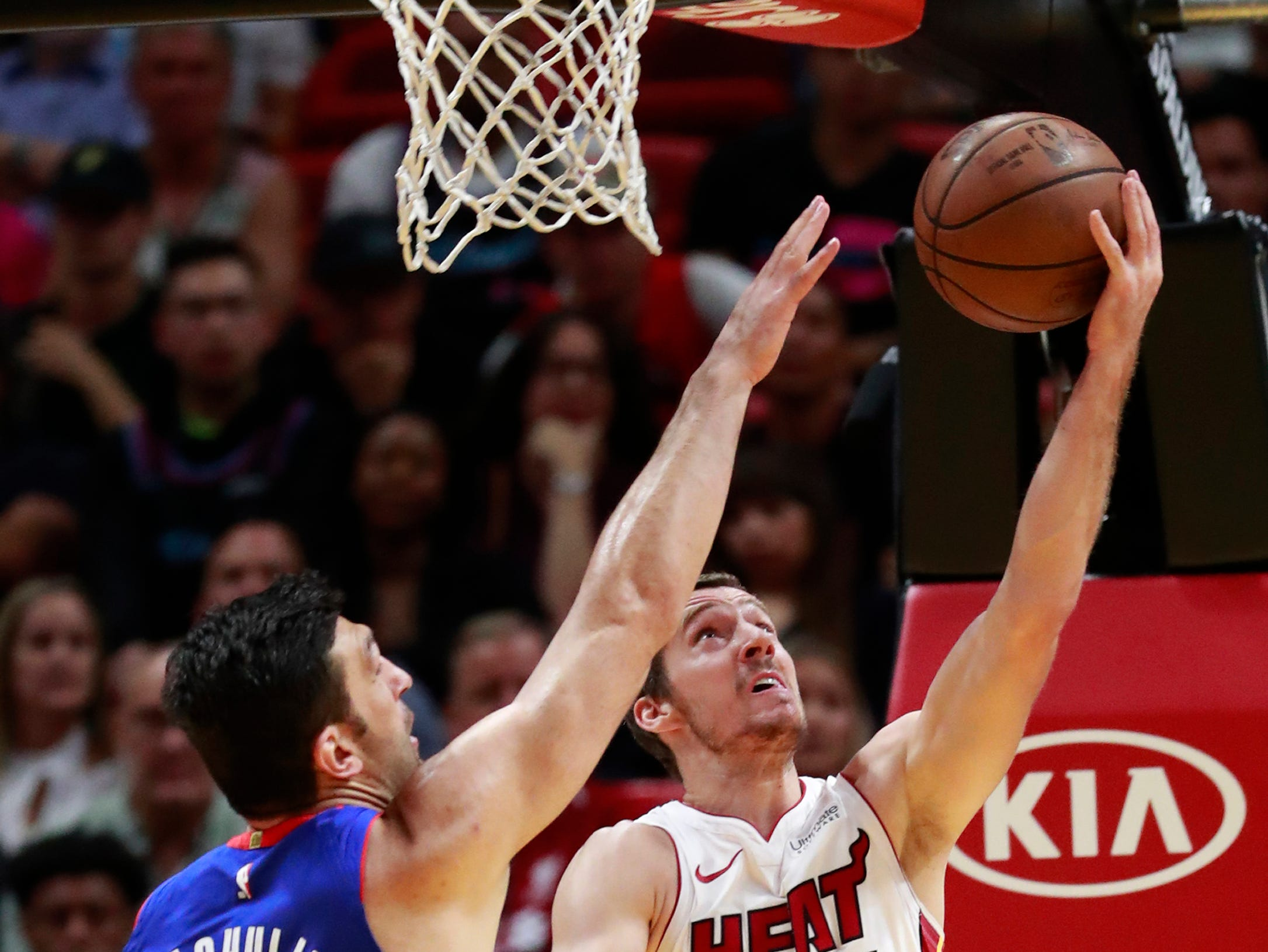 Miami Heat guard Goran Dragic (7) shoots against Detroit Pistons center Zaza Pachulia (27) during the first half.