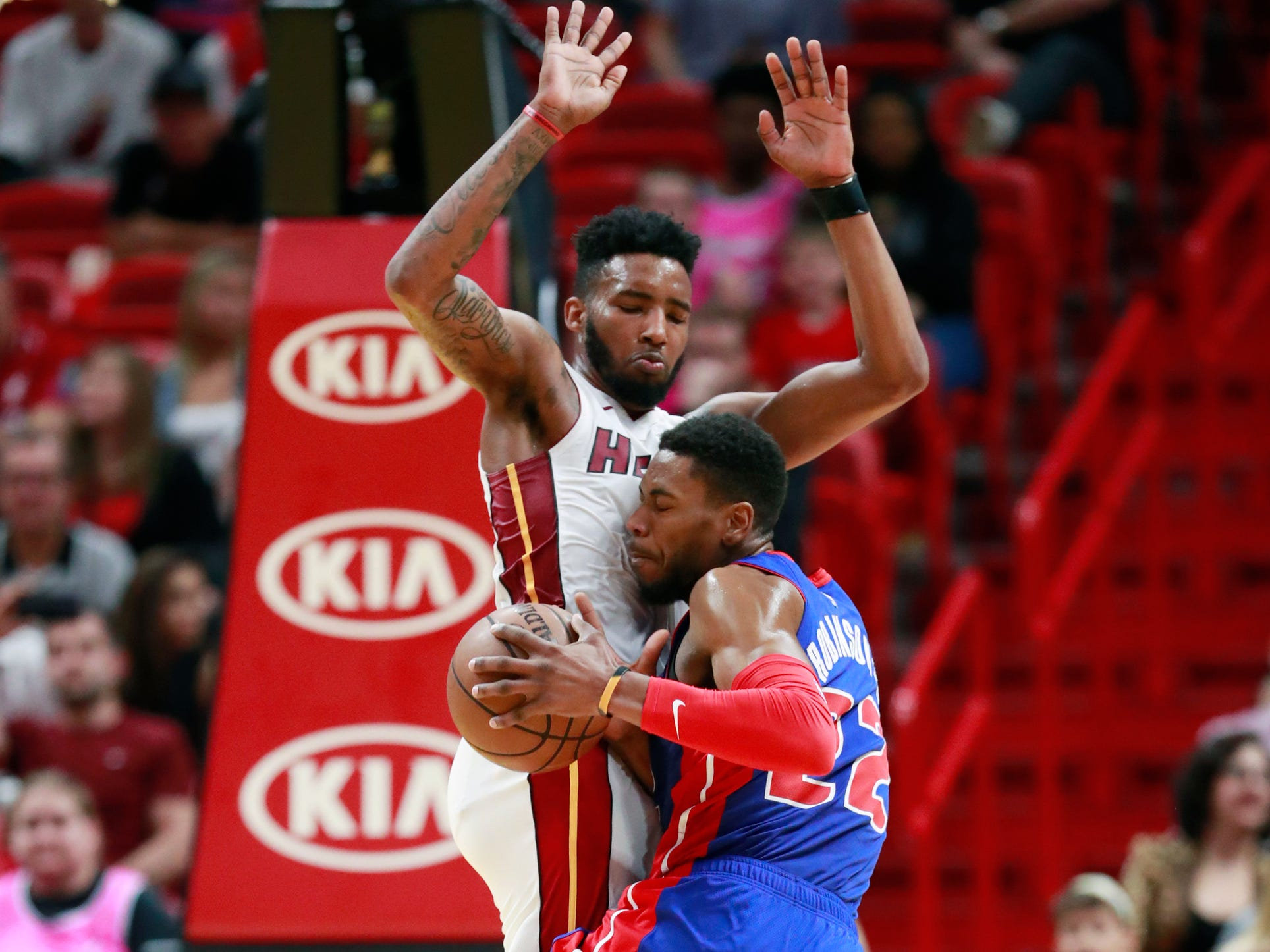 Detroit Pistons guard Glenn Robinson III (22) collides with Miami Heat forward Derrick Jones Jr. as he drives to the basket during the second half.