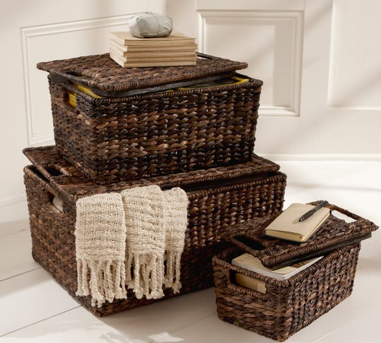 Stacking similar items together like these lidded baskets will make a greater impact in your home.