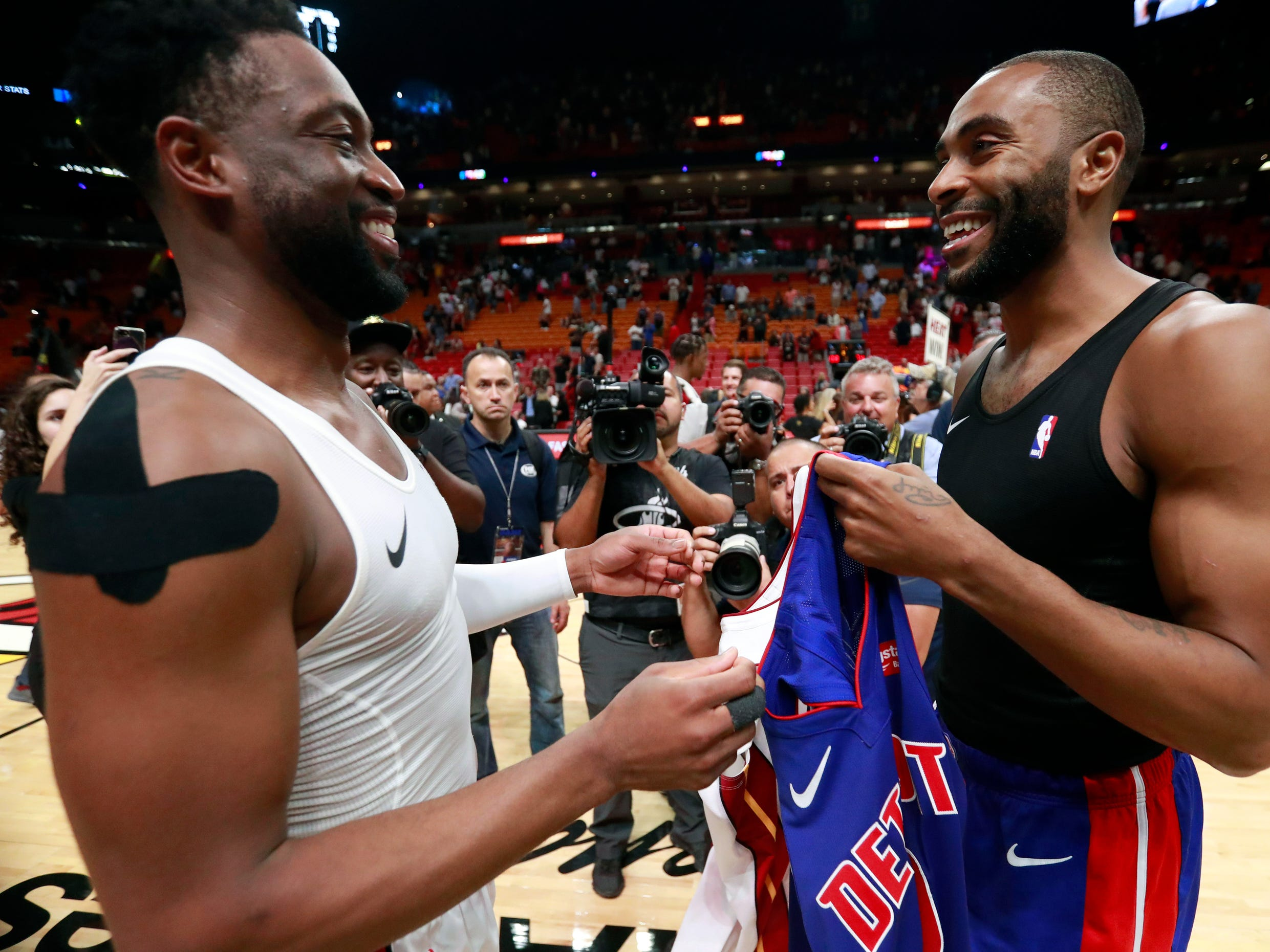 Miami Heat guard Dwyane Wade, left, and Detroit Pistons guard Wayne Ellington smile as they exchange jerseys after the game.