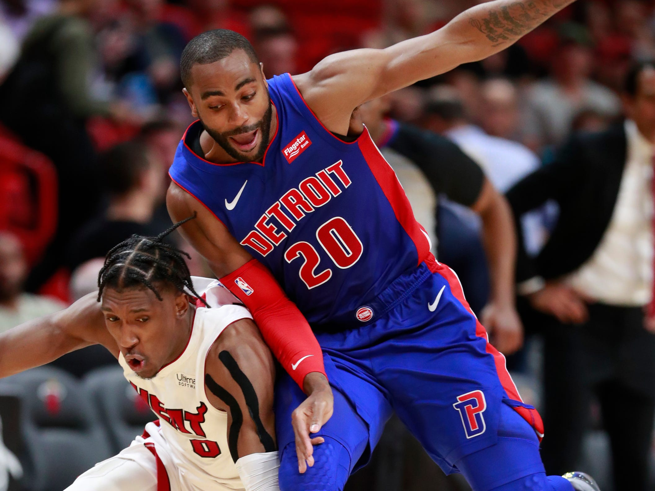 Detroit Pistons guard Wayne Ellington (20) and Miami Heat guard Josh Richardson battle for a loose ball during the second half.