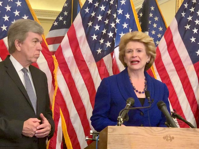 Sens. Debbie Stabenow, right, and Roy Blunt speak at the U.S. Capitol on Thursday, March 14, 2019, about their legislation to expand a pilot program funding mental health services in community health clinics.